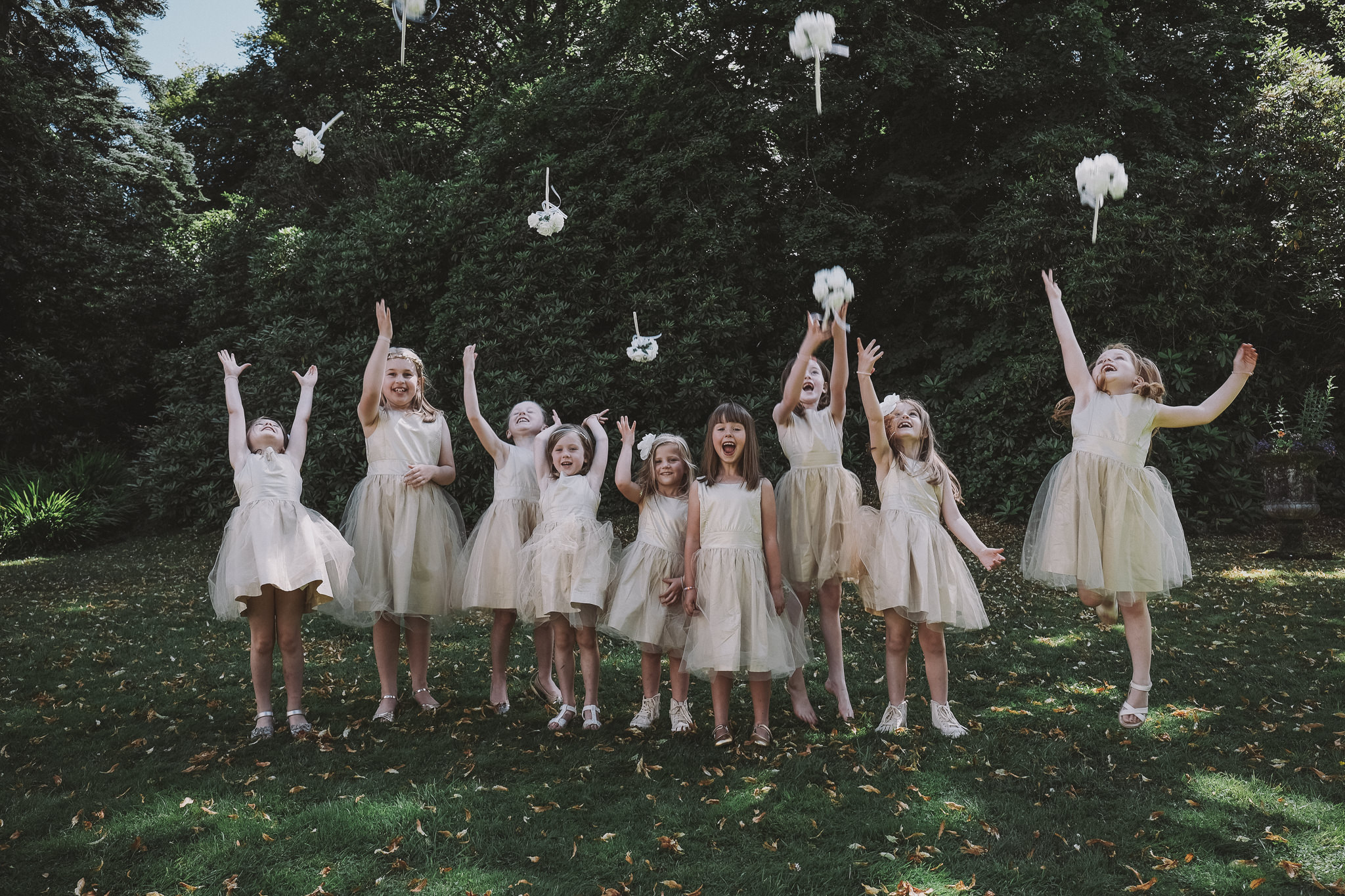 Flowergirls throw their bouquets in the air in the Lake District