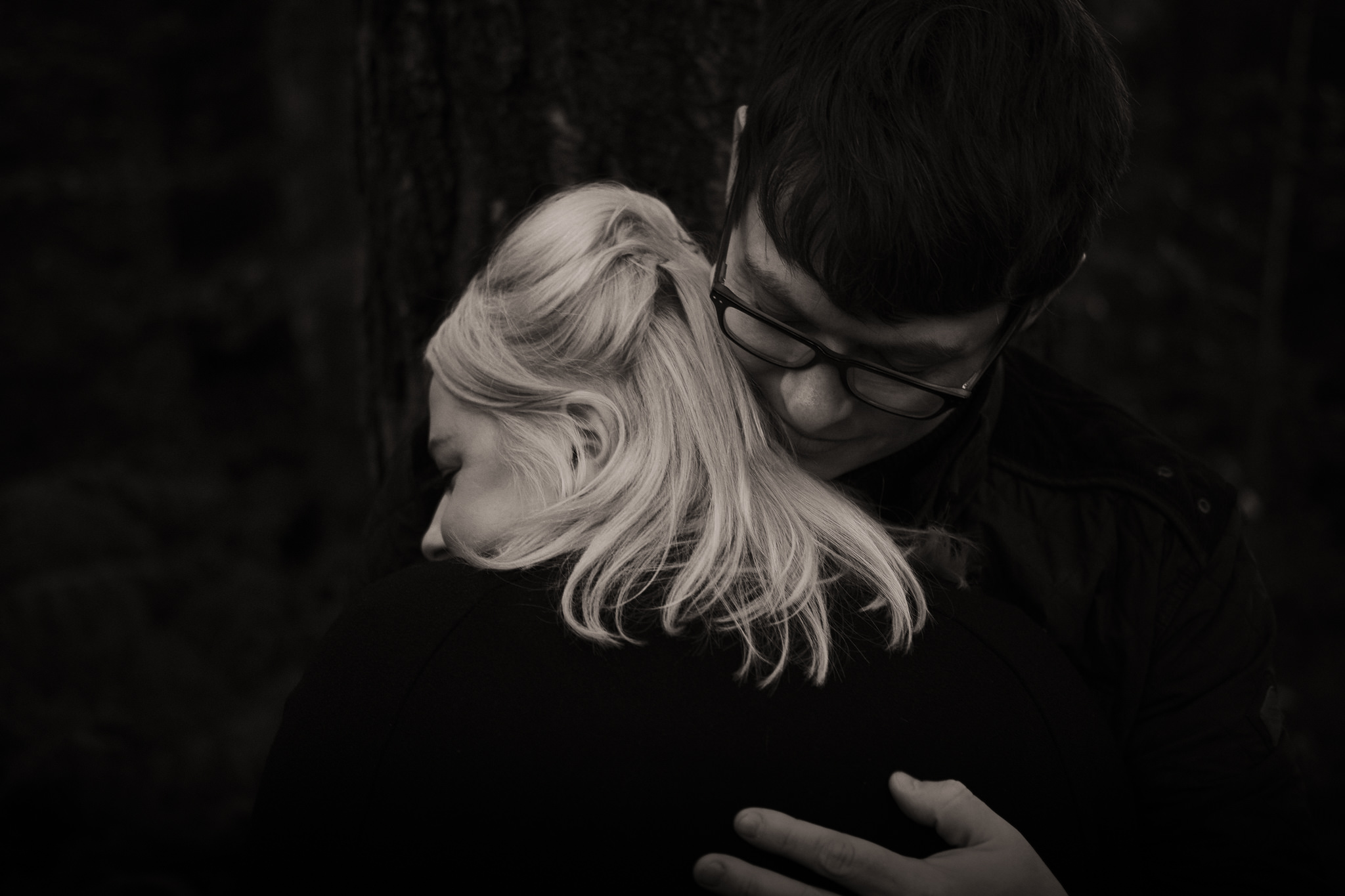 Black and white close up of couple holding each other tight on pre-wedding shoot in Gateshead