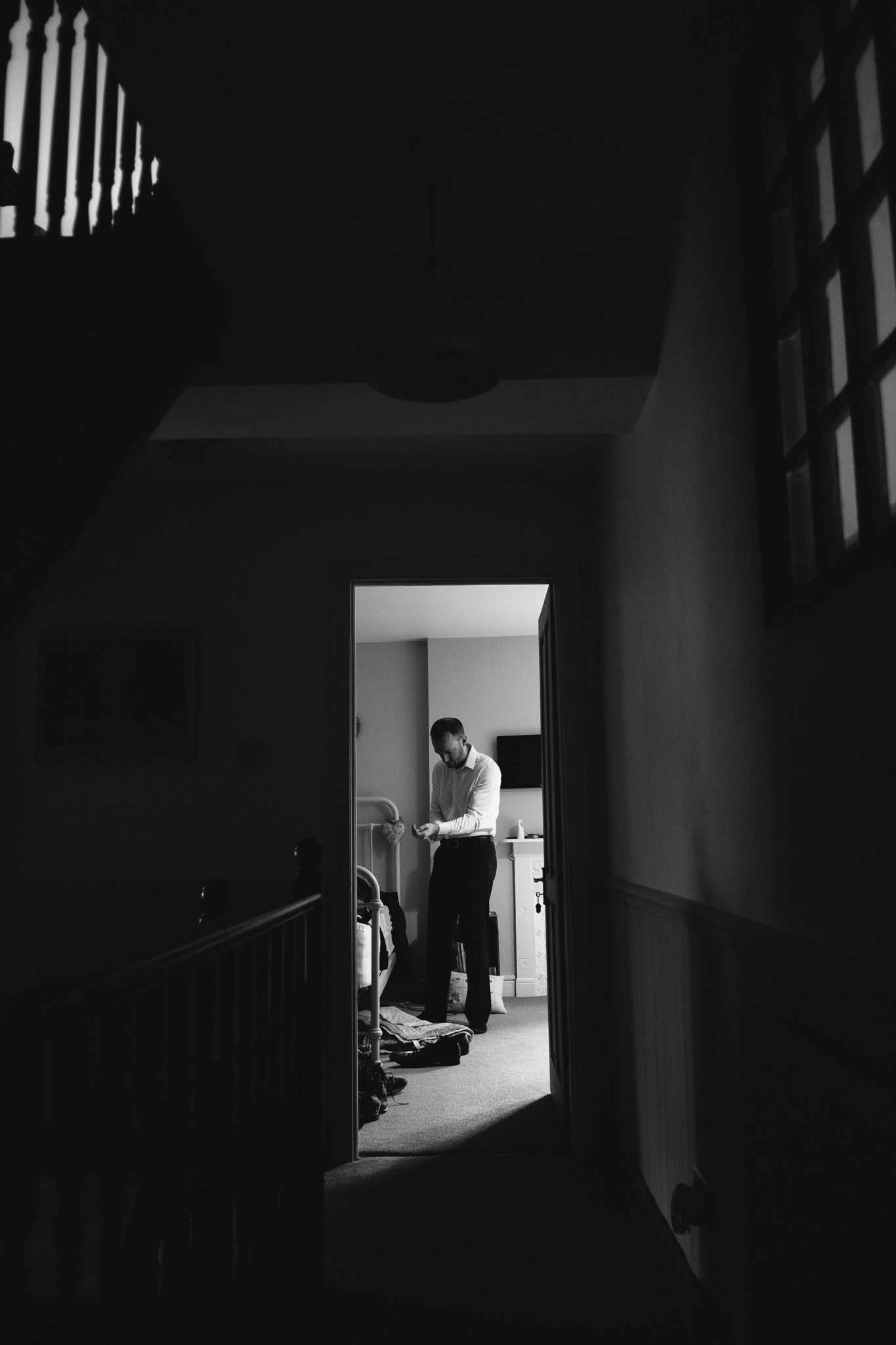 Black and white photo of a groomsman getting ready in a Yorkshire wedding