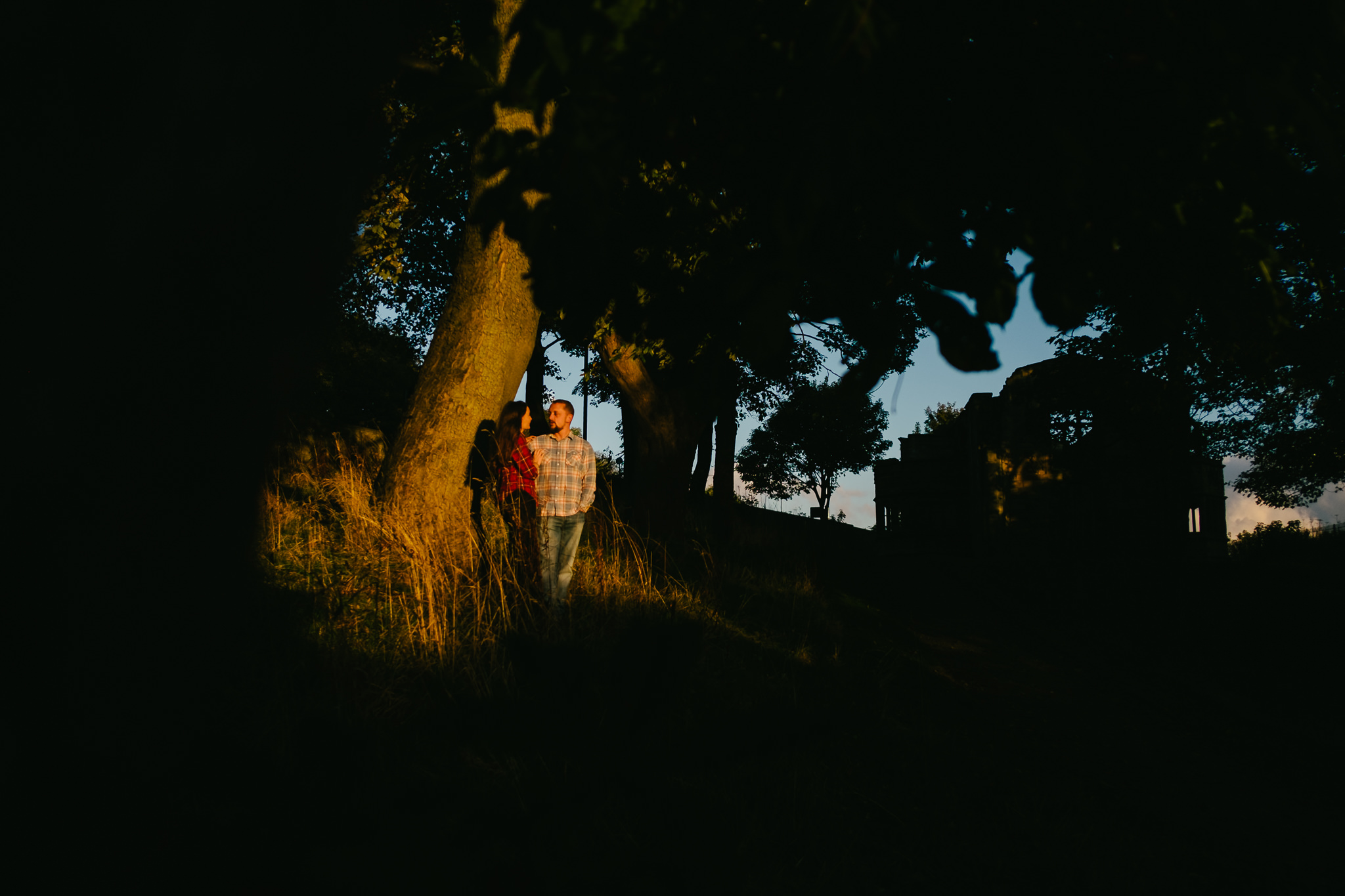 Engaged couple bathed in a pocket of autumn sun in Sunderland