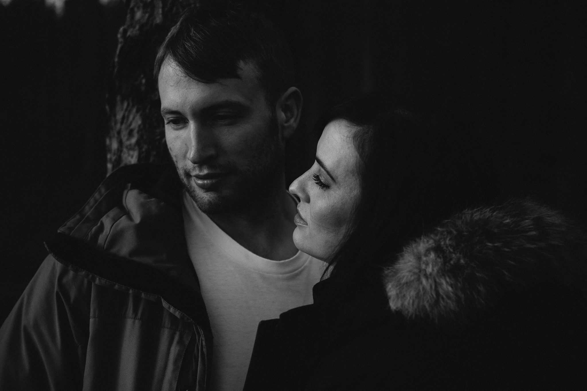 Black and white photo of the couple embracing on a pre-wedding shoot