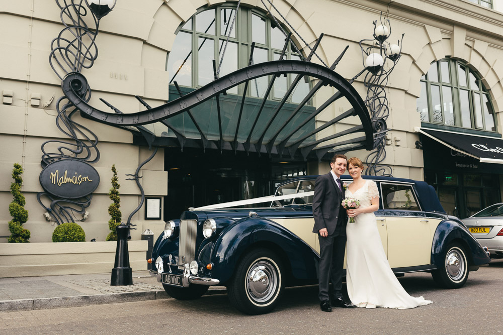 Bride and groom with wedding car outside Malmaison Newcastle by Barry Forshaw