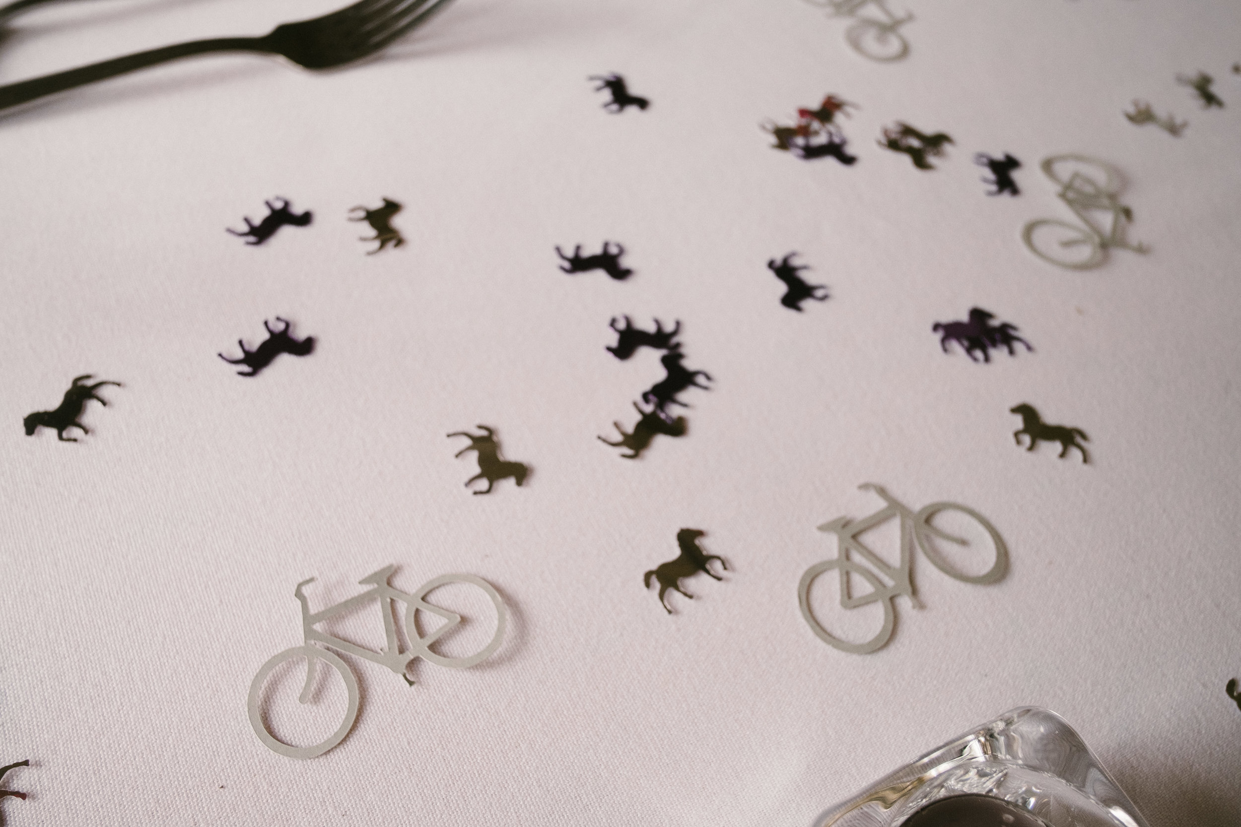 Bicycle confetti on tables at Dale Farm wedding