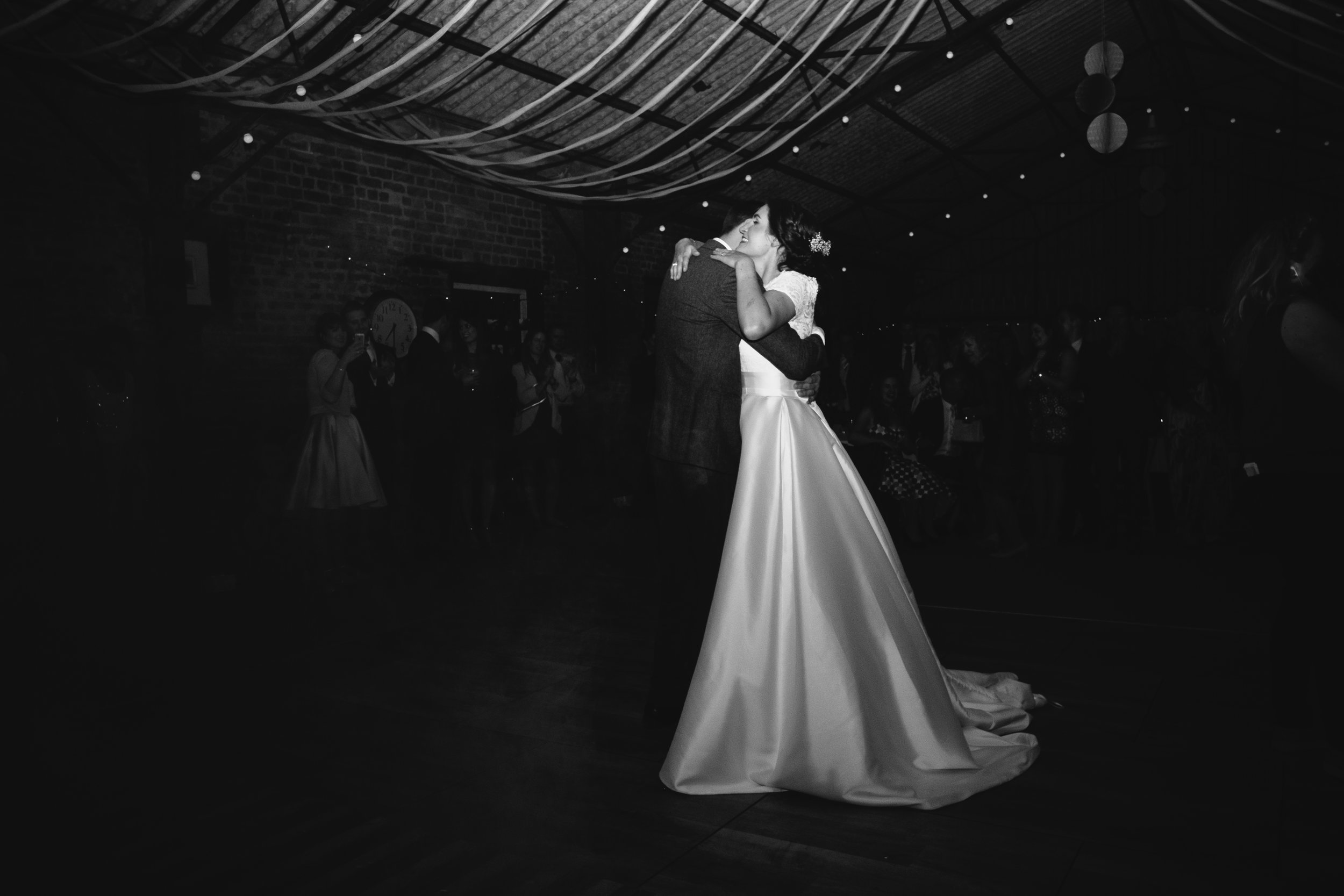 Black and white photo of the bride and groom first dance at Dale Farm Yorkshire