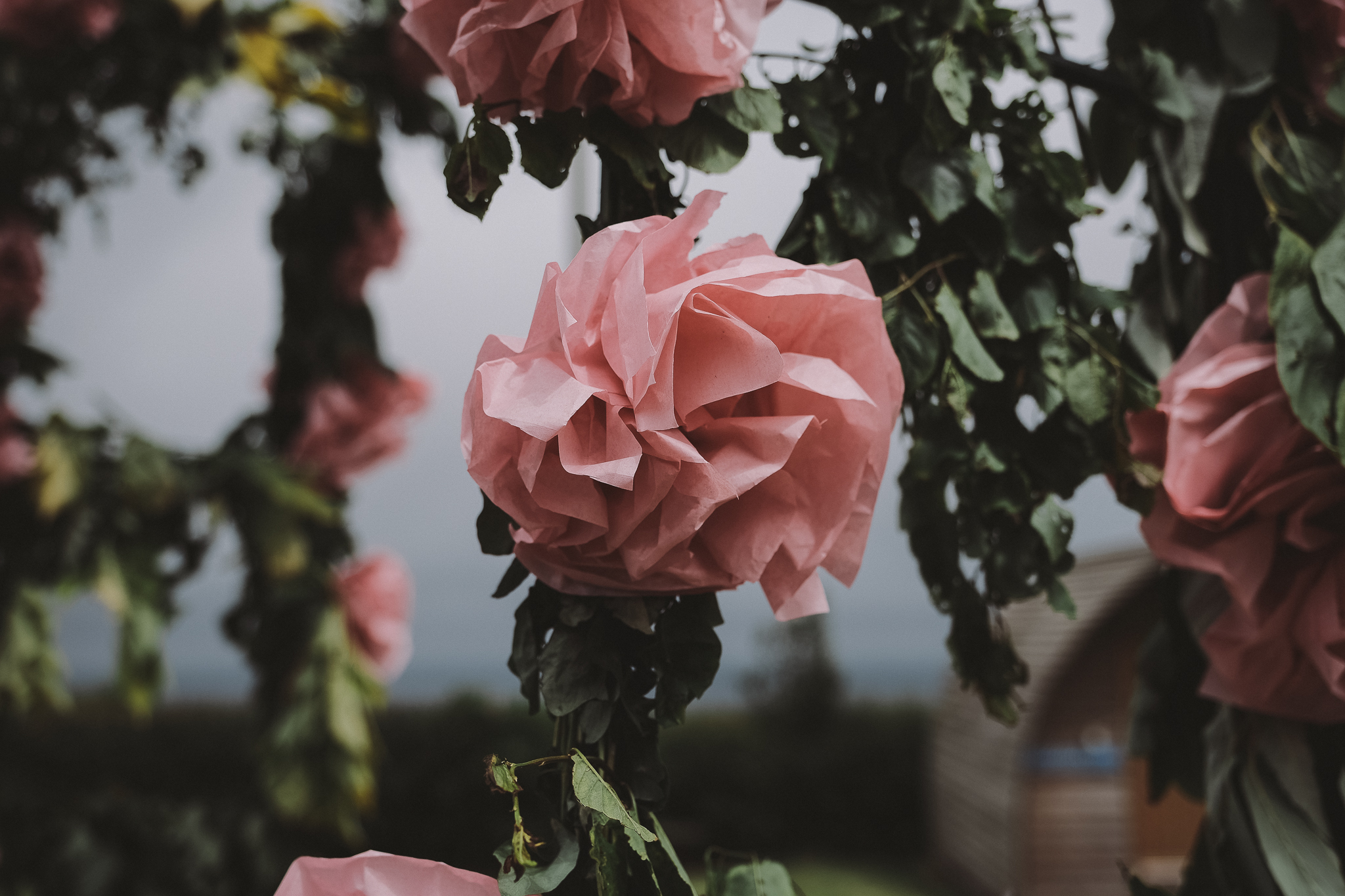 Close up of homemade paper flower for outdoor wedding ceremony