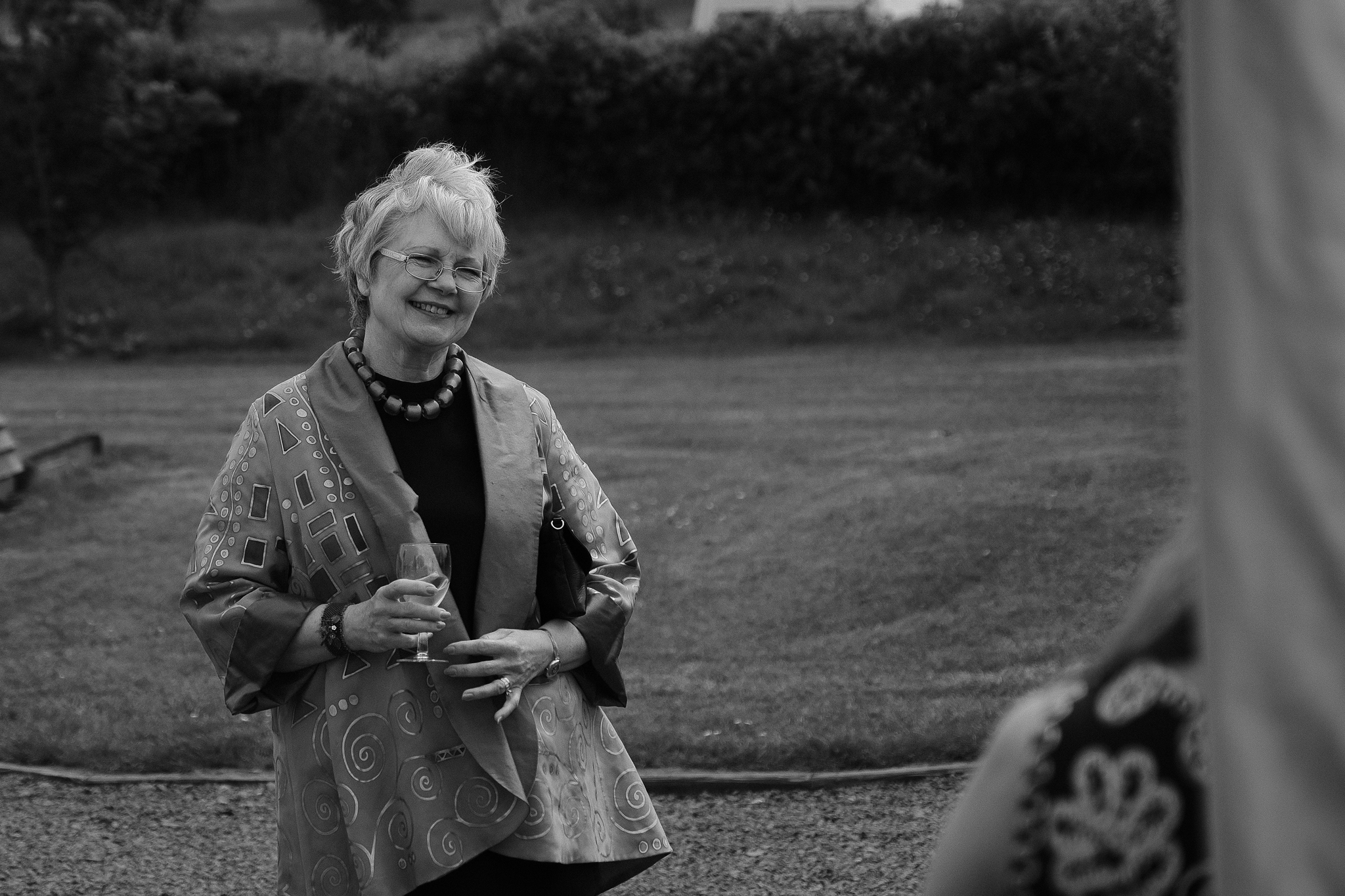 Black and white photo of the mother of the bride smiling