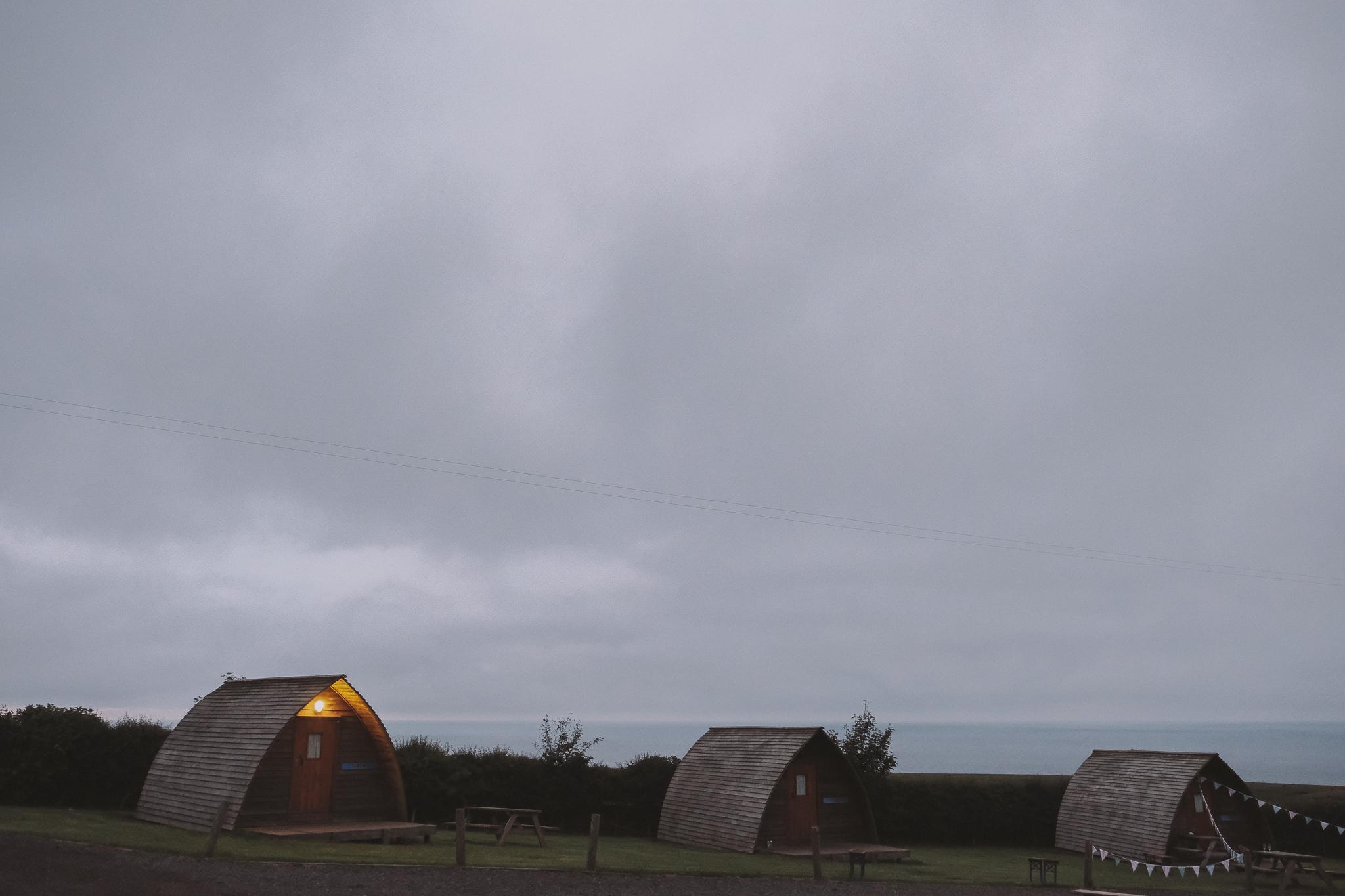 Wooden wigwams at sunset at Potadoodledoo