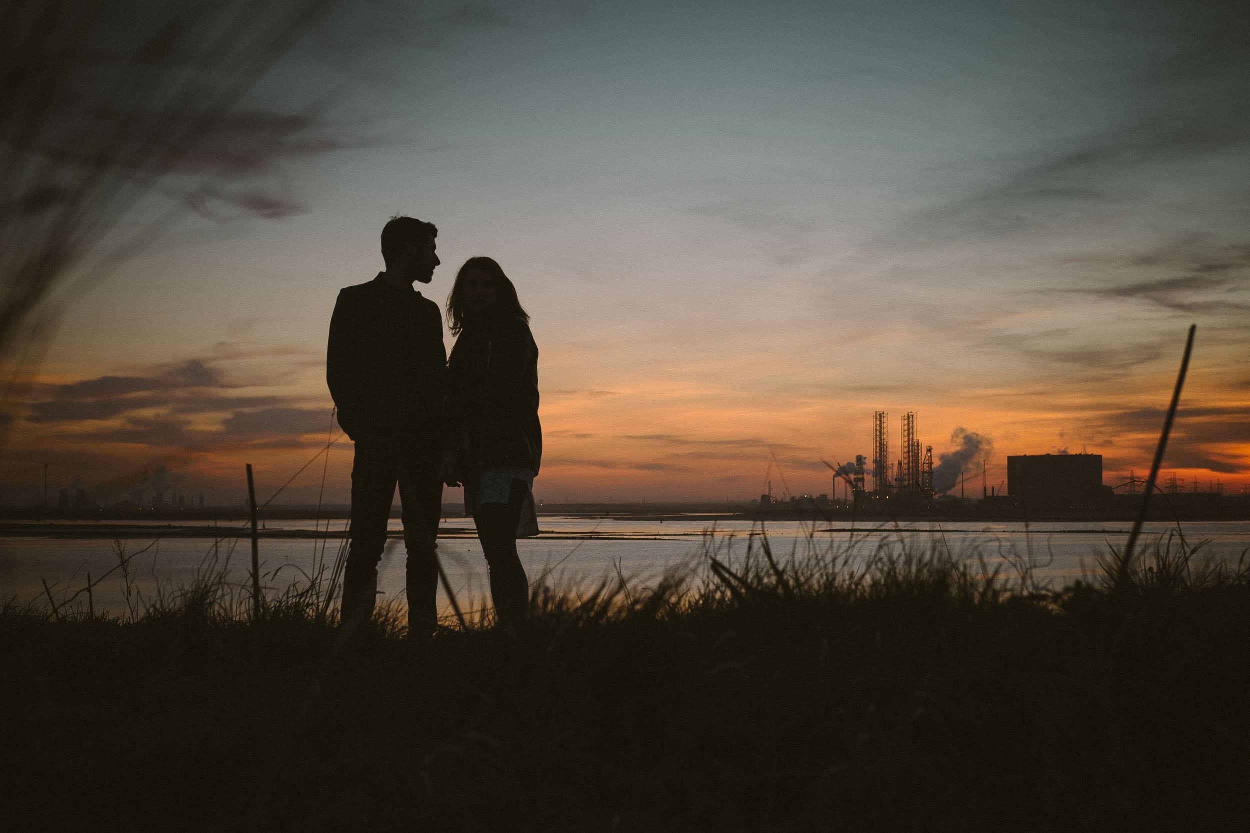 Silhouette of couple at sunset on Teeside coast