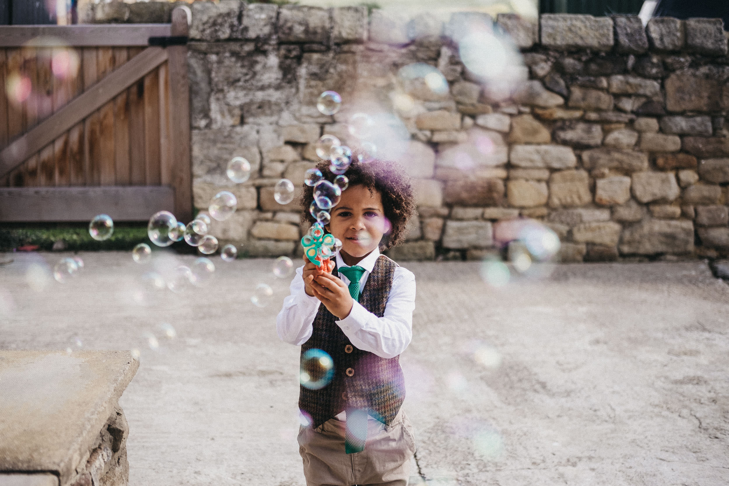 Smartly dressed page boy blows bubbles at Northside Farm Newcastle