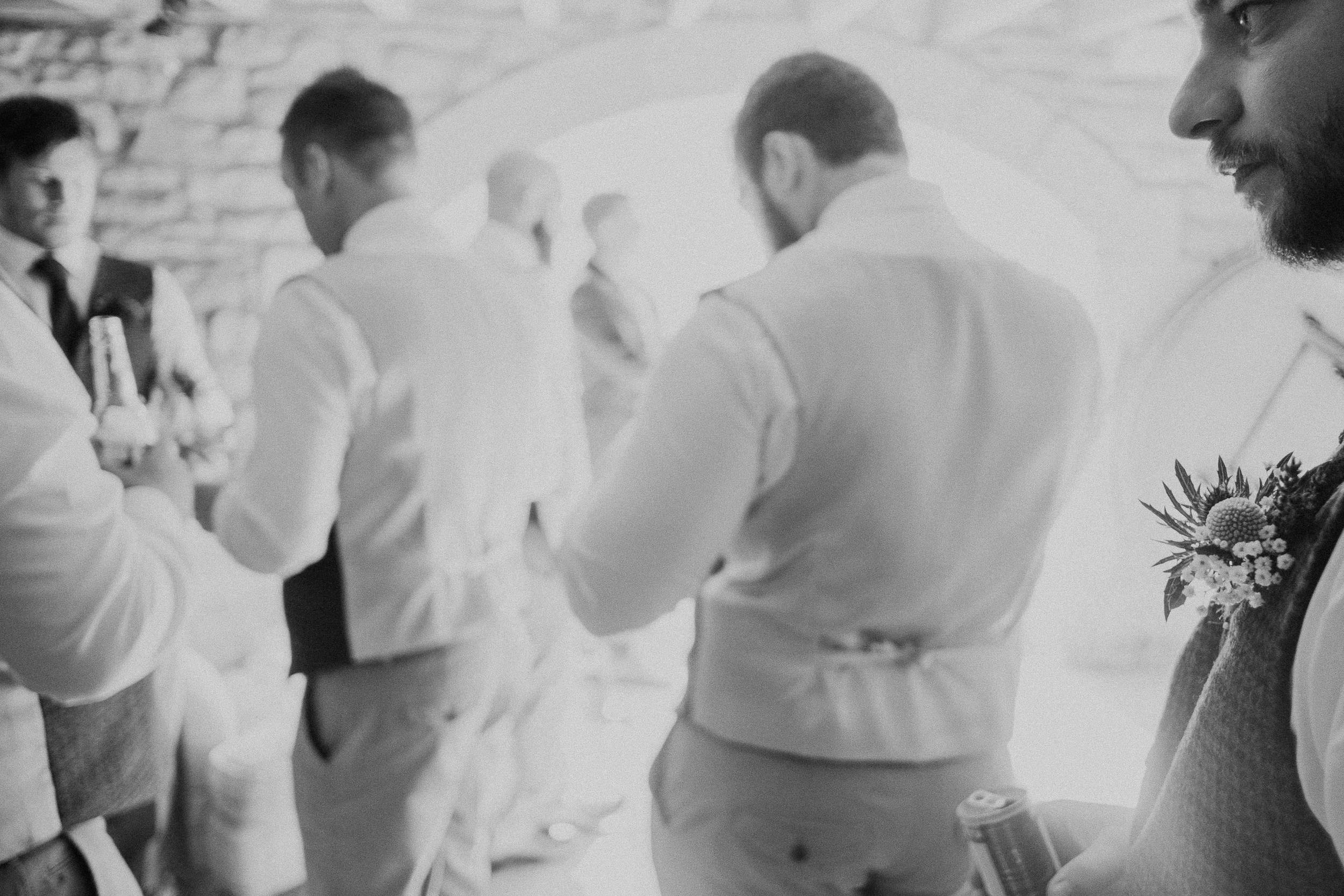 Black and white photo of groomsmen getting ready at Northside Farm Newcastle