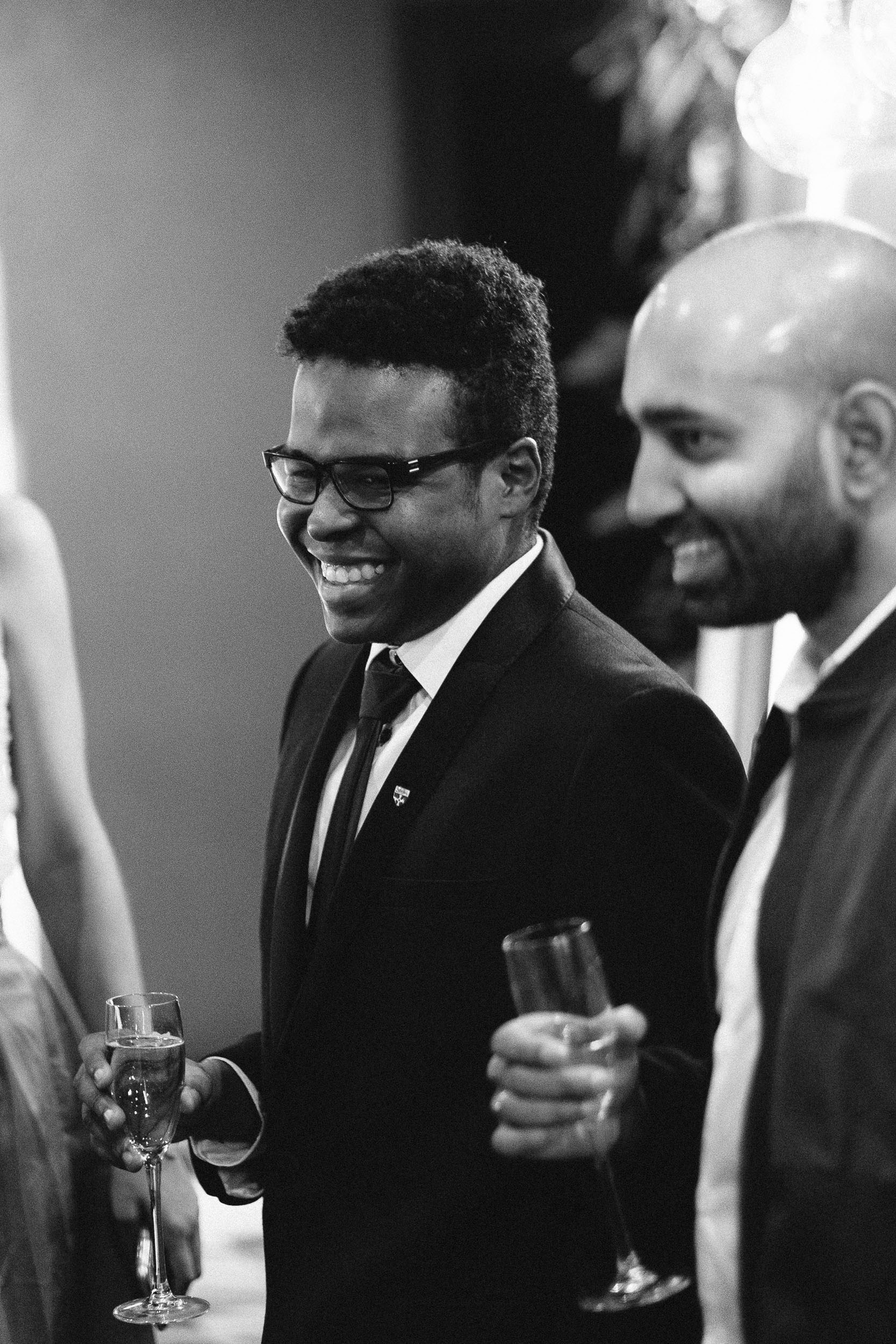 Black and white photo of guest laughing at Malmaison wedding