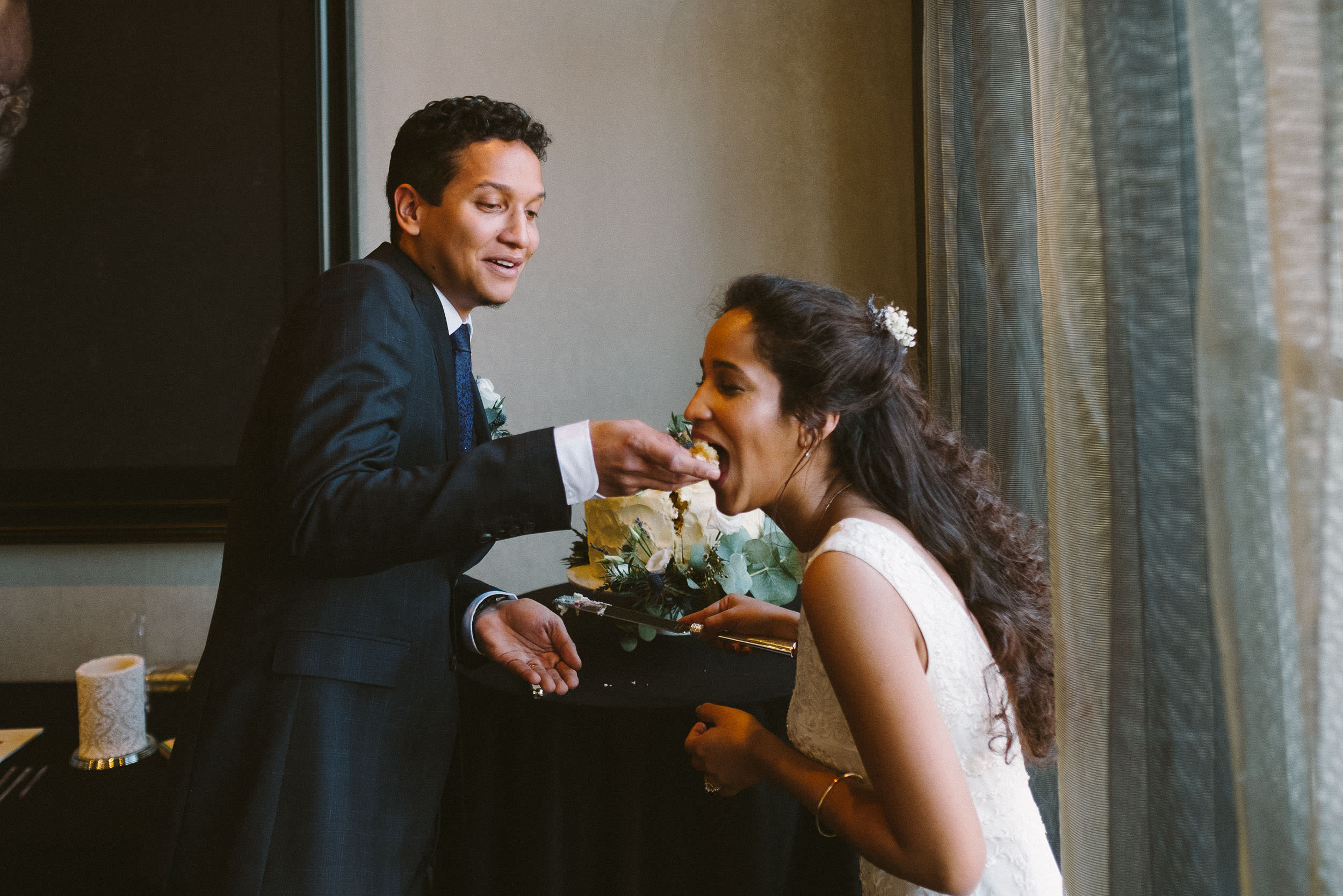 Groom feeds bride wedding cake at Malmaison Newcastle