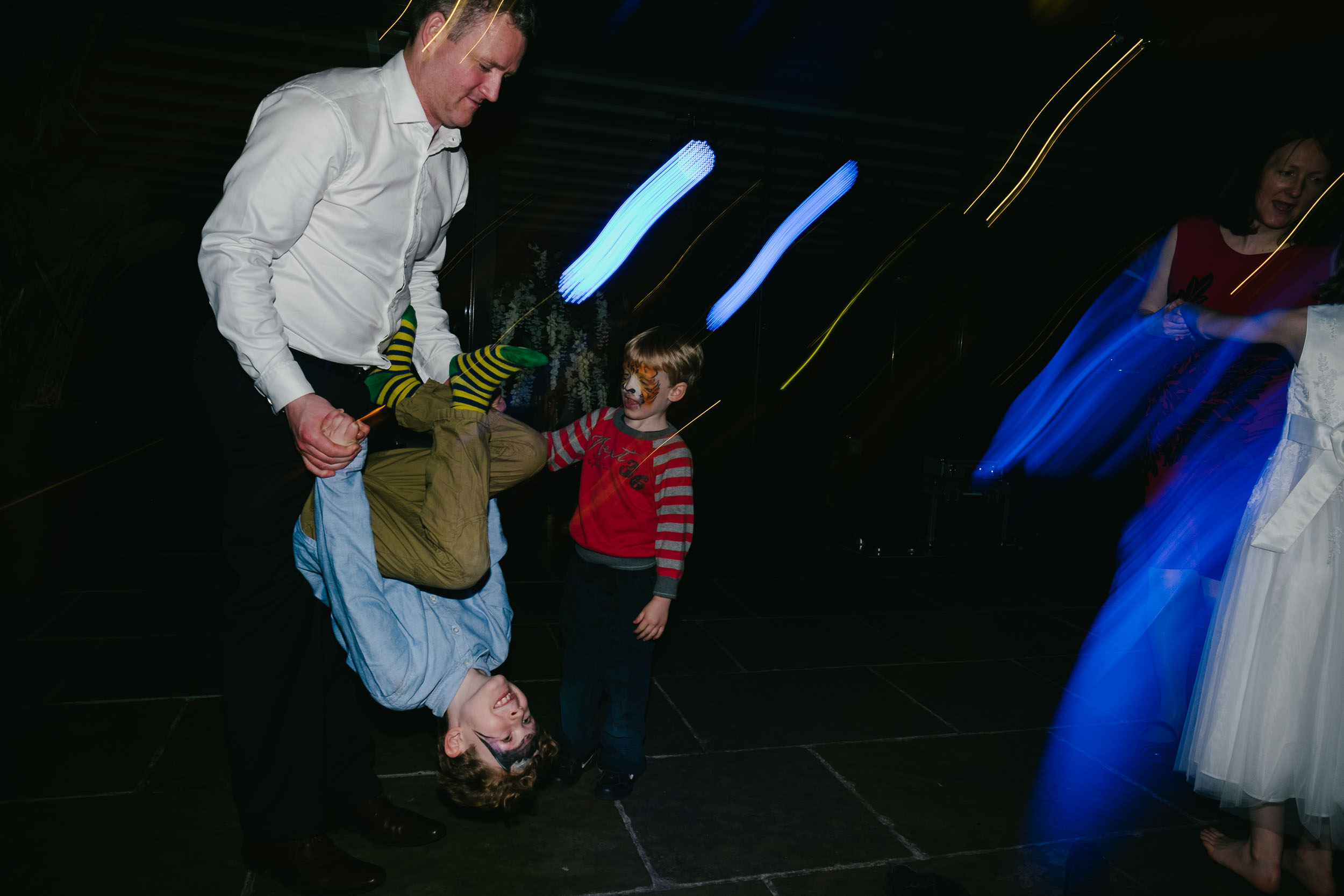 Dad spins son upside down at wedding at Le Petit Château