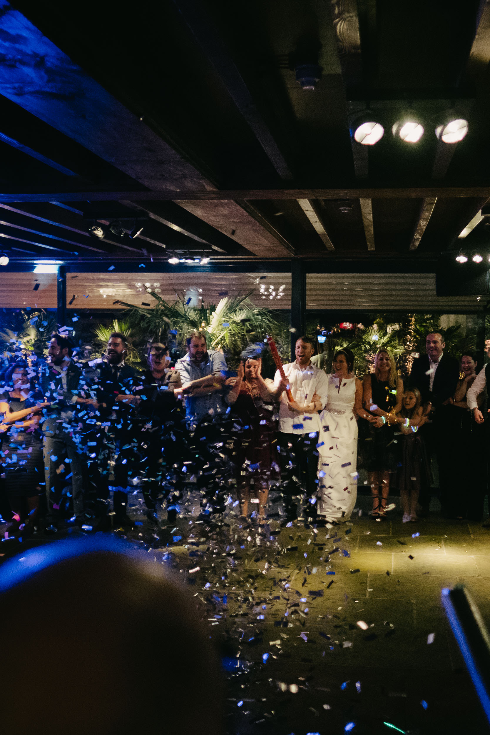 Le Petit Château is showered in confetti as the guests look on