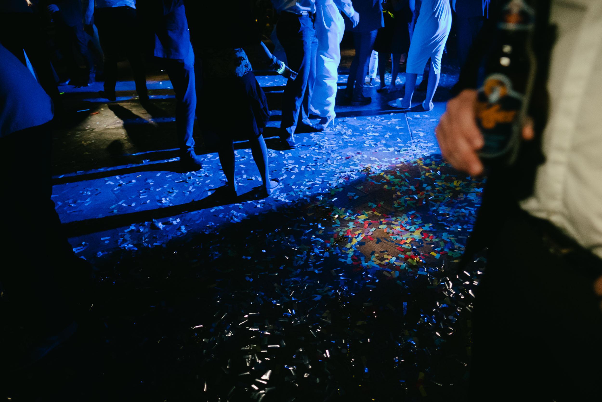 The floor of Le Petit Château is covered in confetti