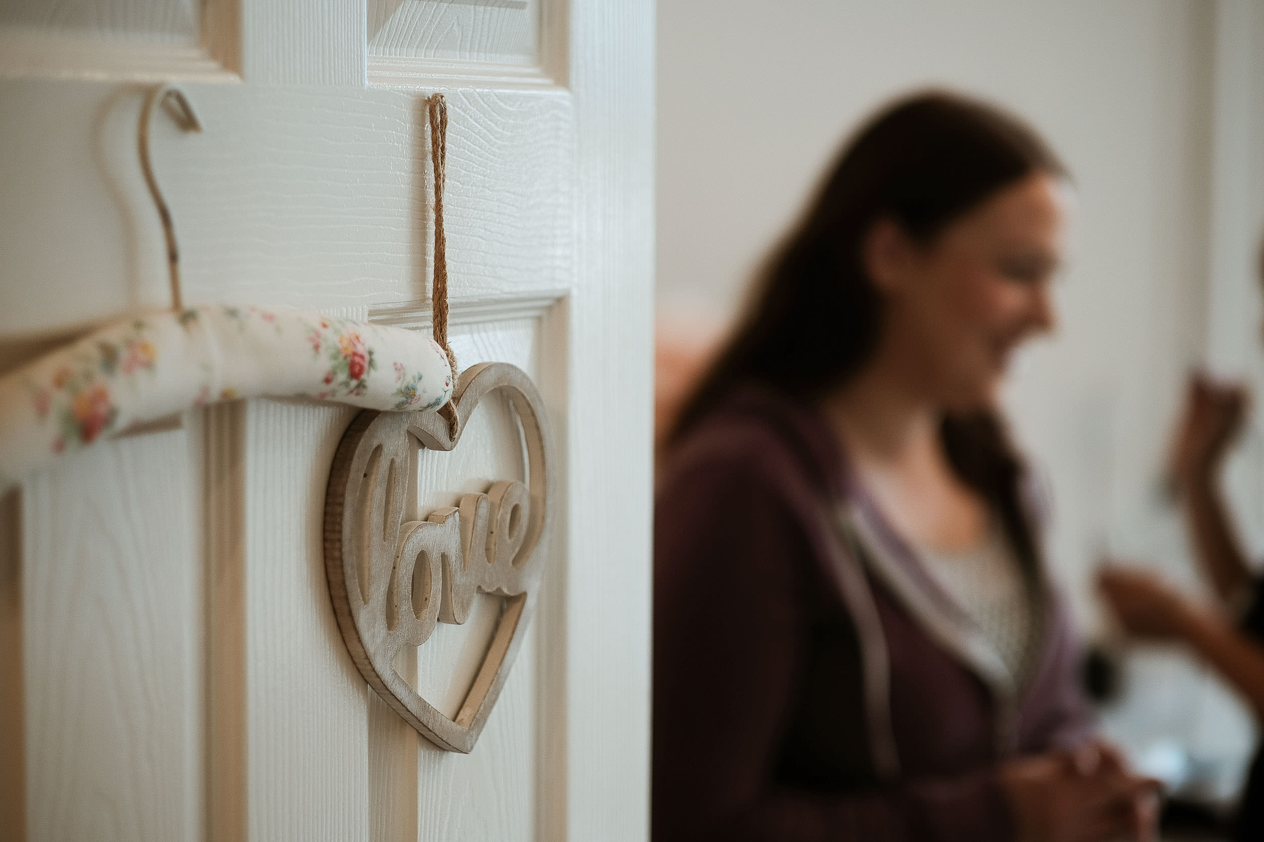 Close up of love sign with bride in the background