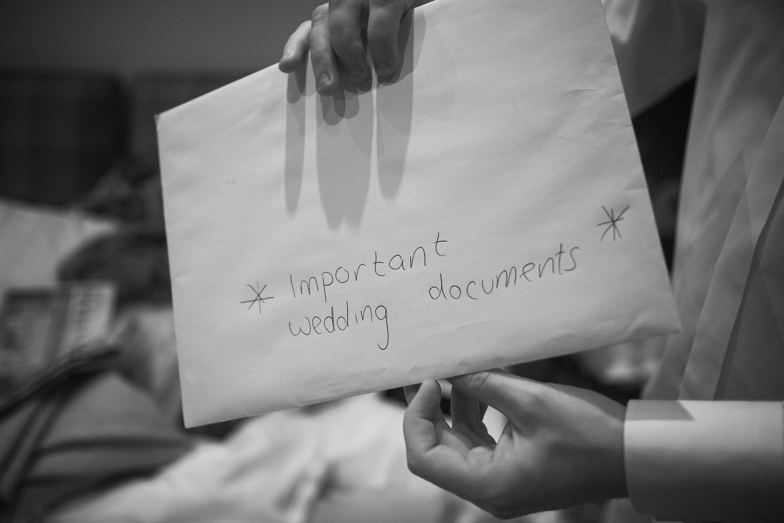 Black and white photo of envelope reading *important wedding documents*