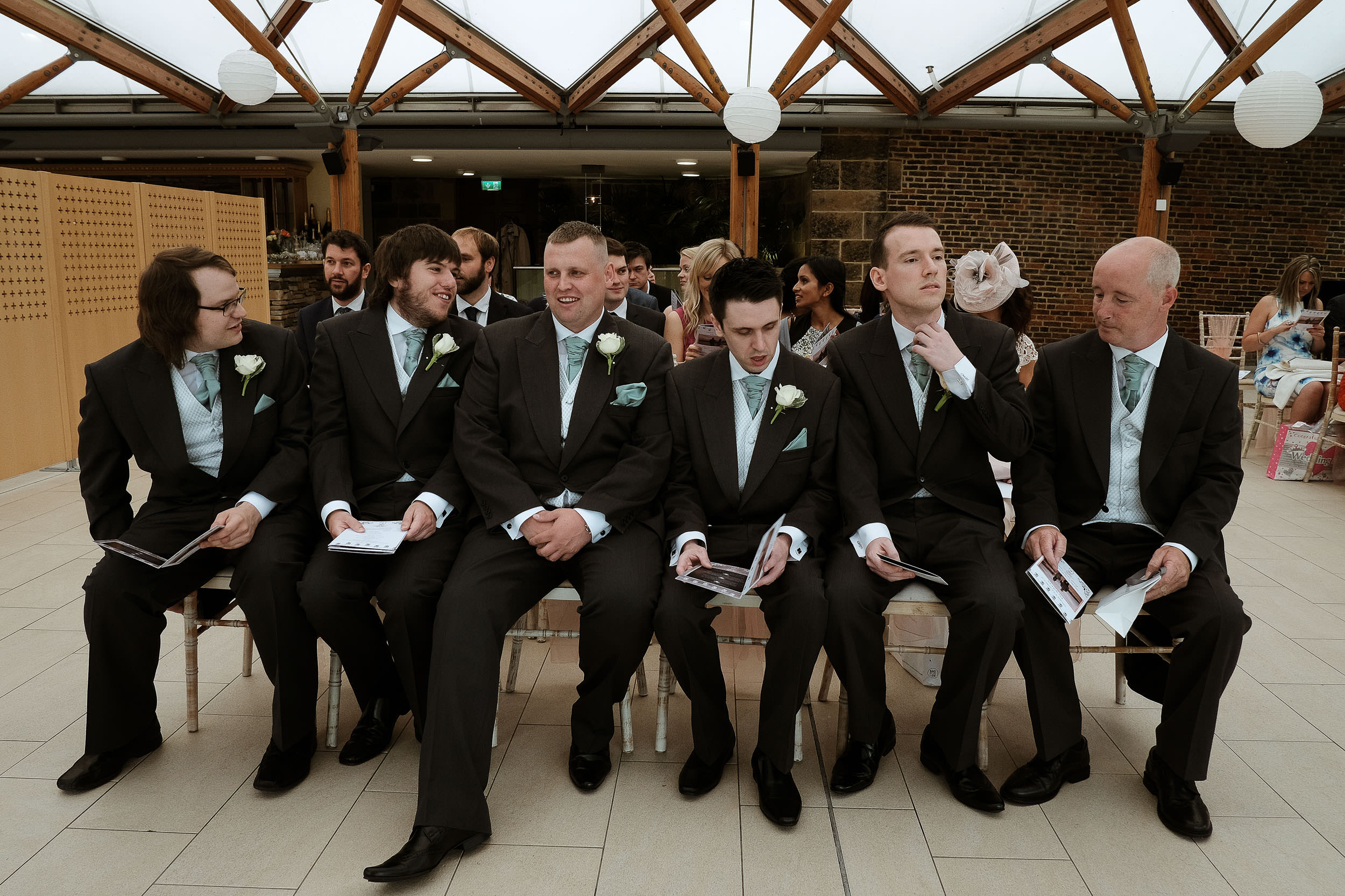 Groomsmen waiting for wedding ceremony to start at the Alnwick Garden