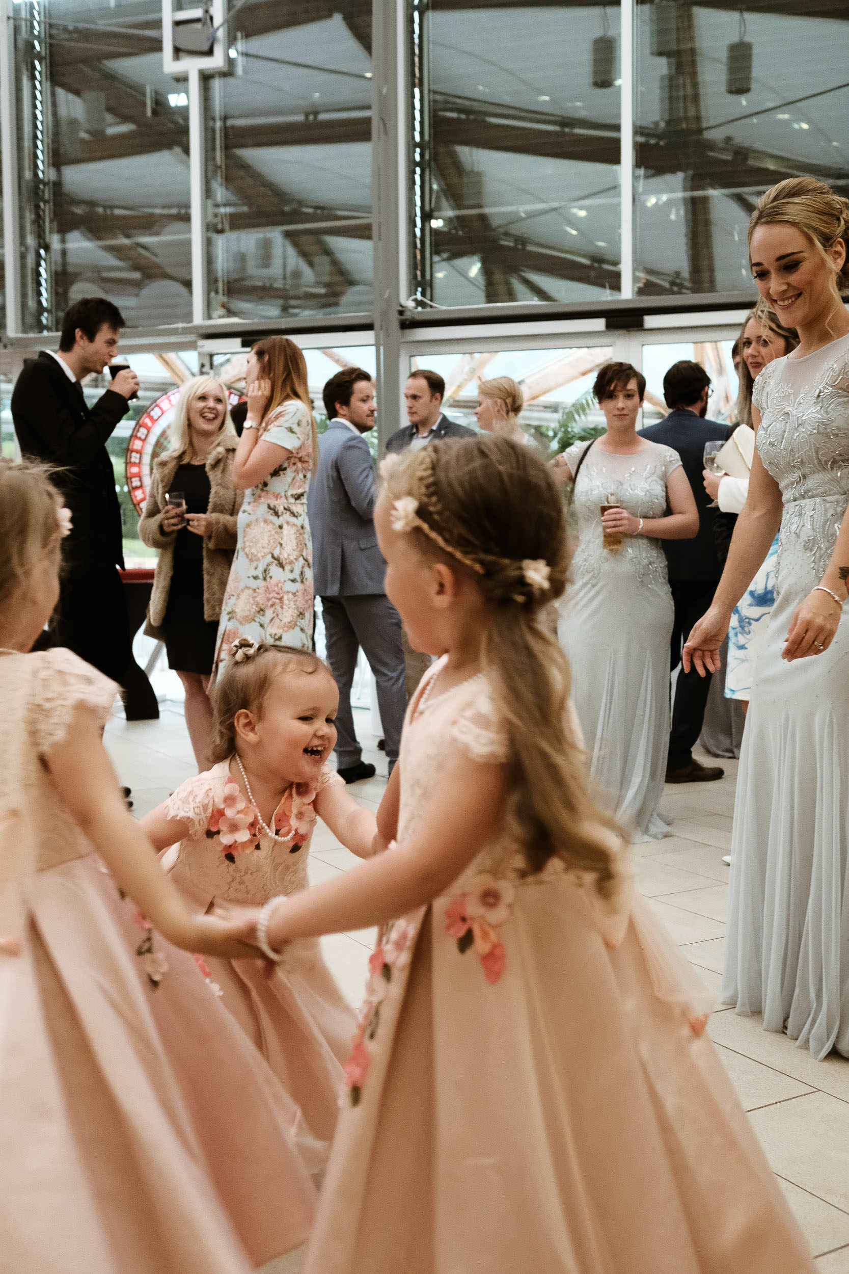 Flower girls dancing hand in hand