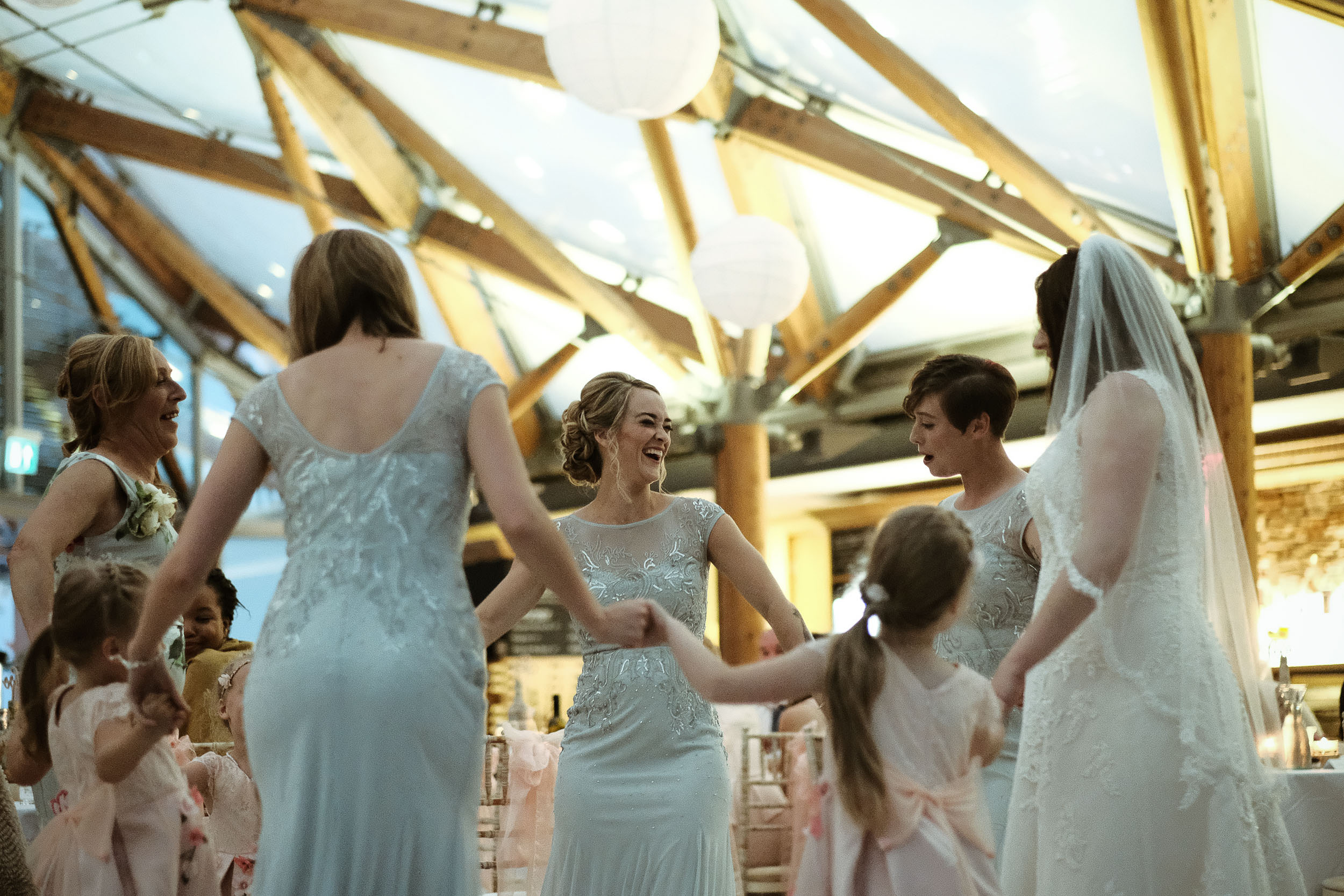 Bride and bridesmaids dancing at Alnwick Garden wedding