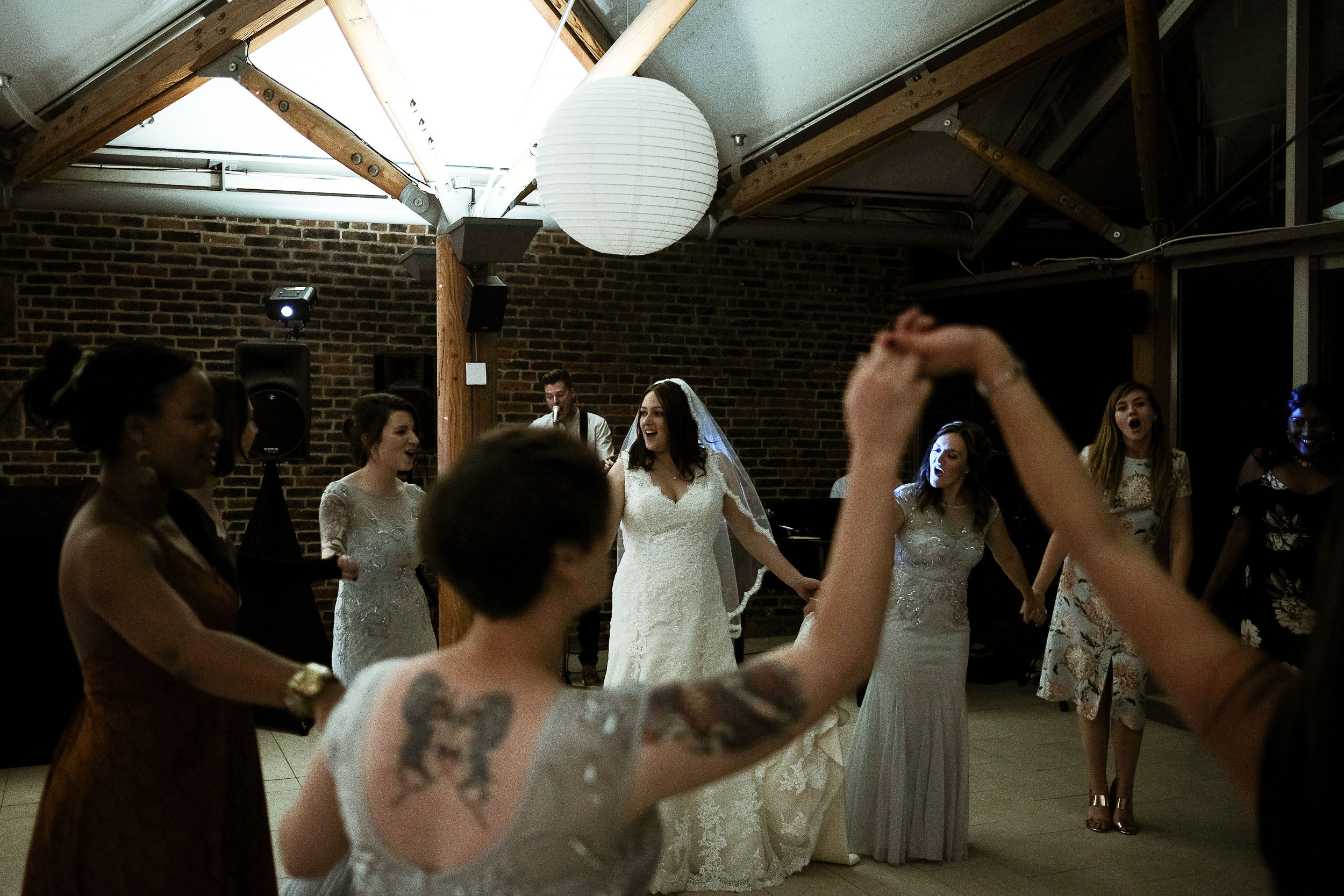 Bride and bridesmaids dance as the band plays