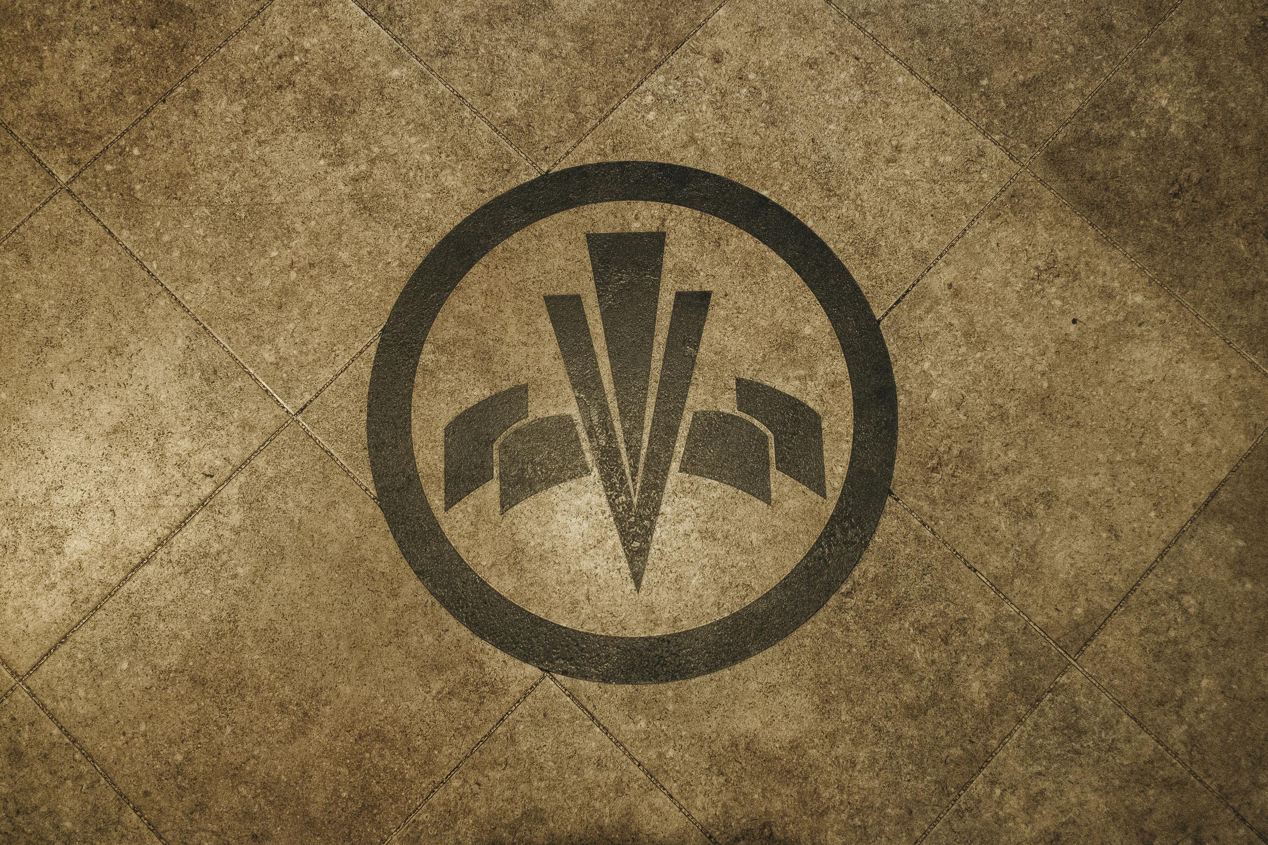 Vermont Hotel logo on marble floor