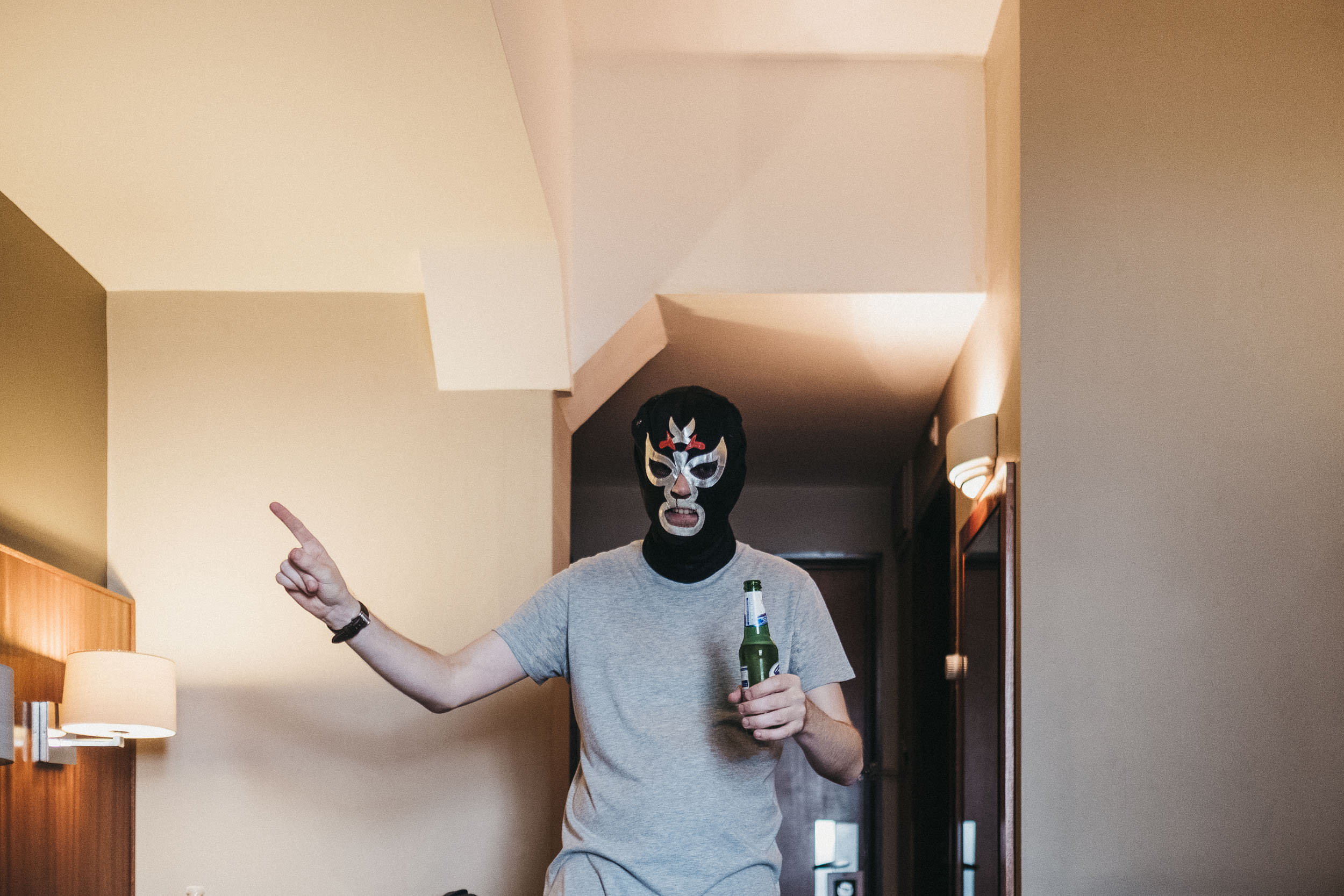 Groom wearing a Mexican wrestling mask