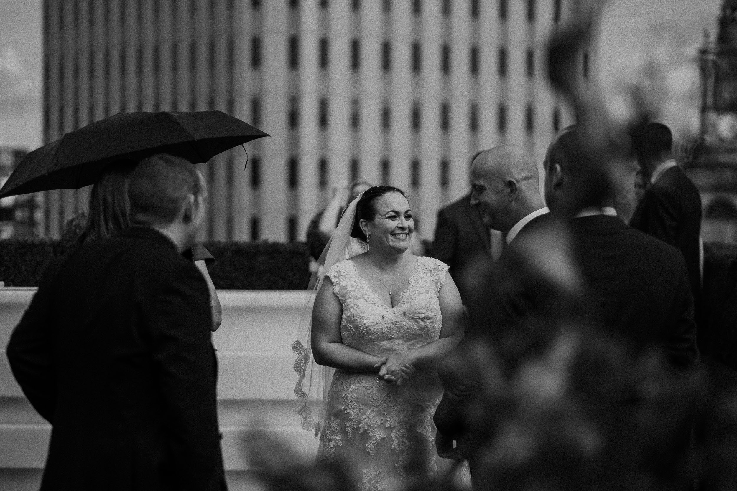 Black and white photo of the bride laughing in the Sky Garden of the Vermont Hotel