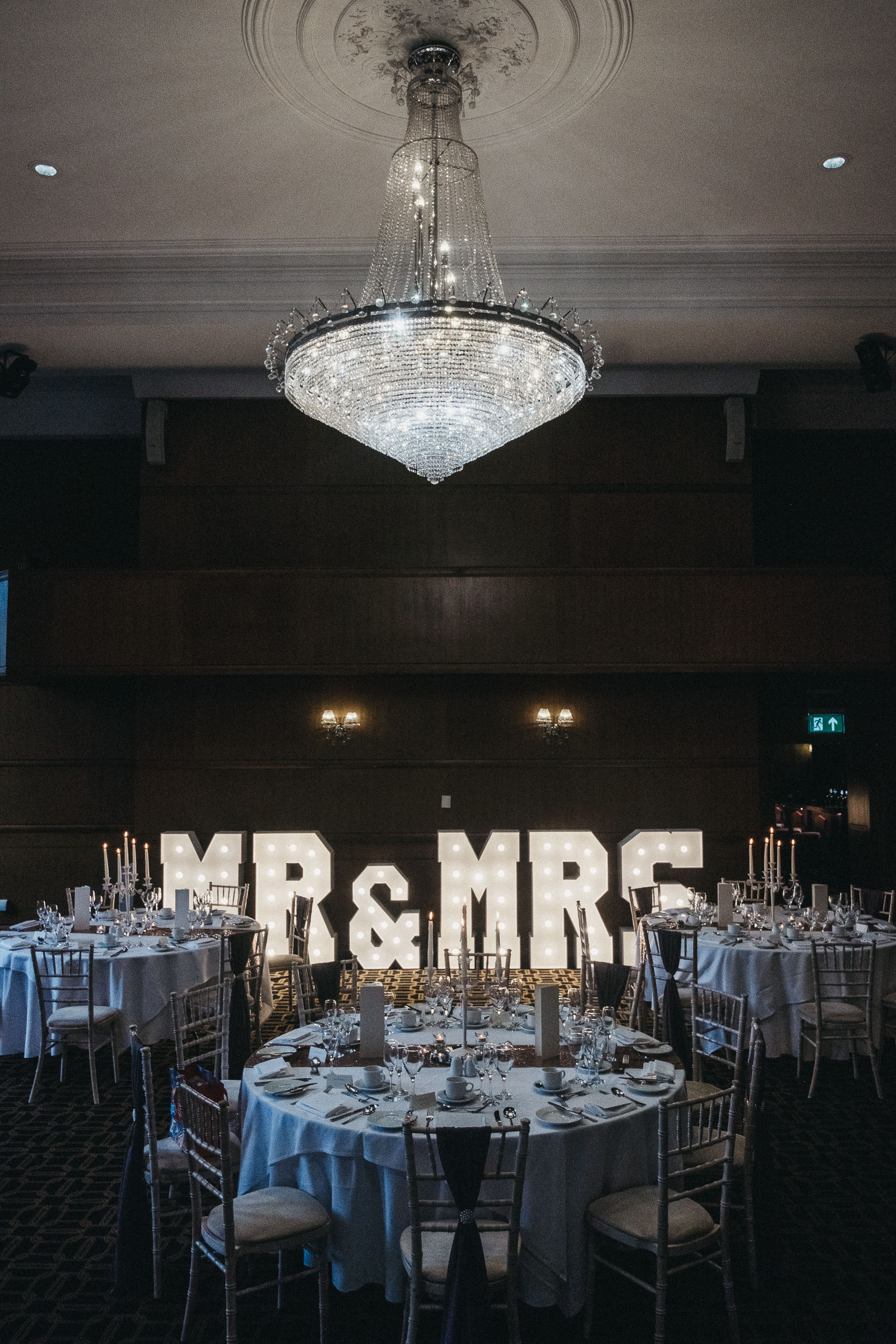 Reception room in the Vermont Hotel with grand chandelier and Mr & Mrs sign
