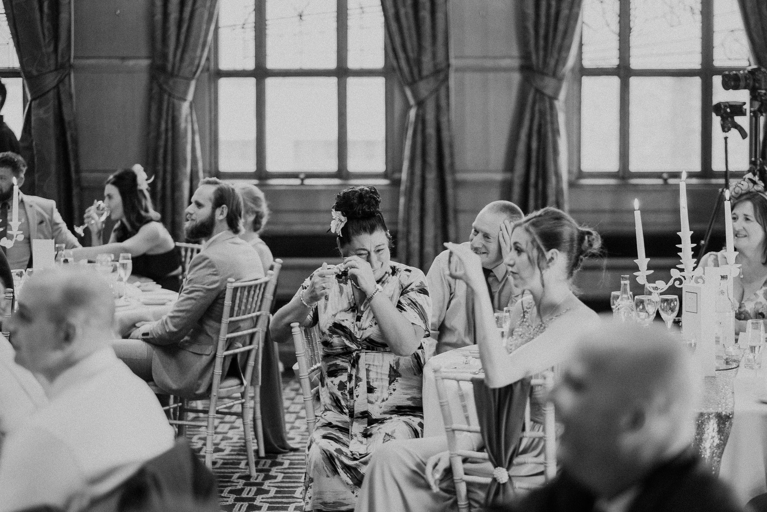 Black and white photo of guest crying during speeches