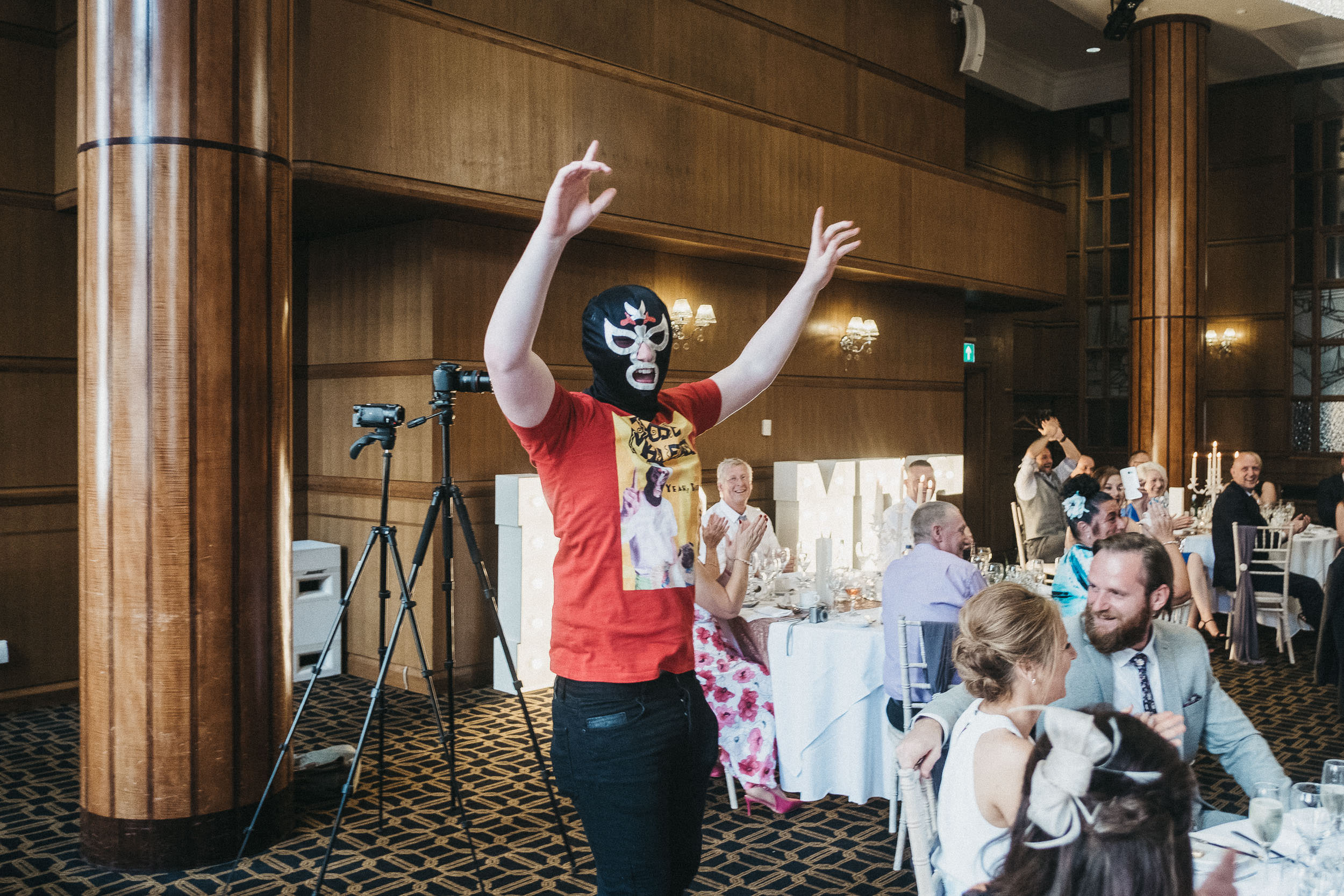 Mexican wrestler waving arms in the air at the Vermont Hotel