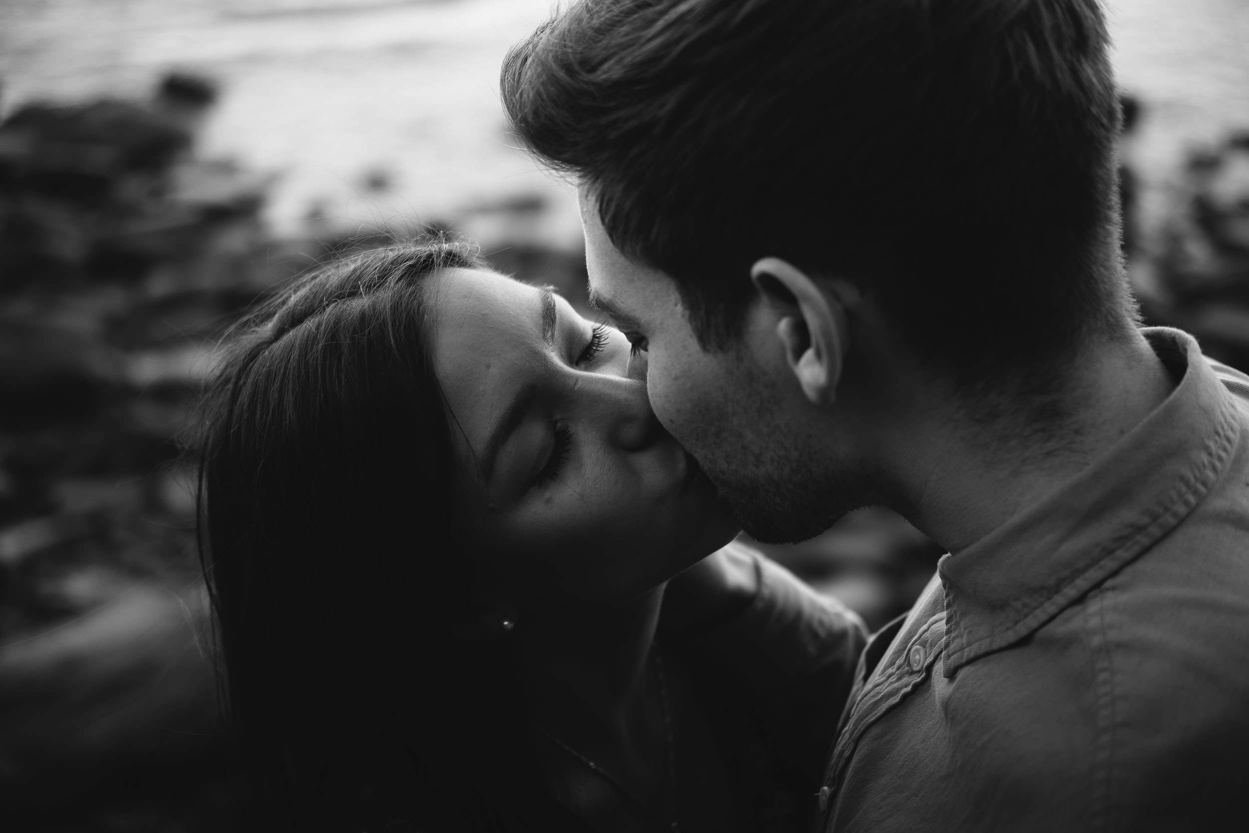 Black and white close up photo of couple kissing