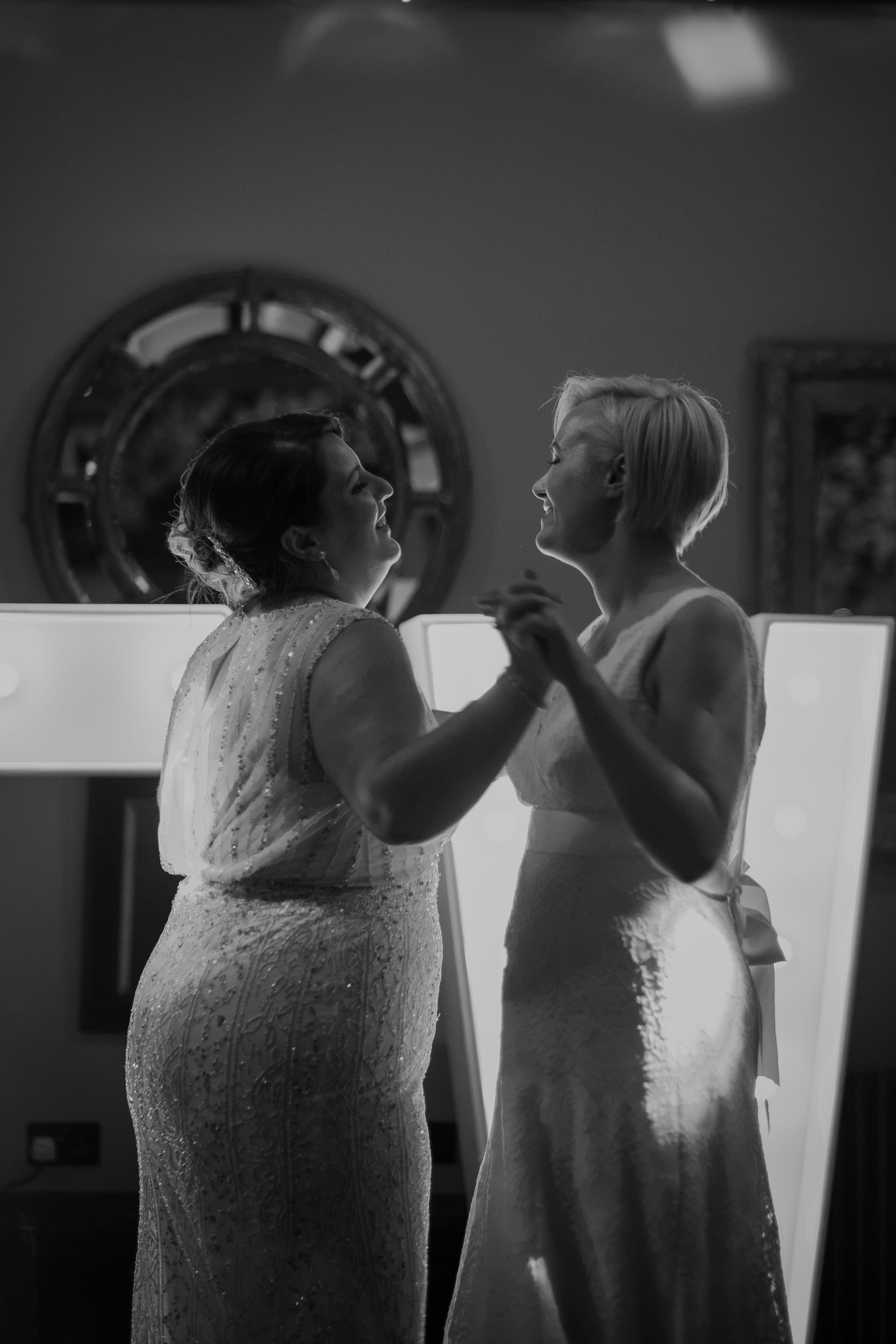 Black and white photo of two brides dancing at South Causey Inn