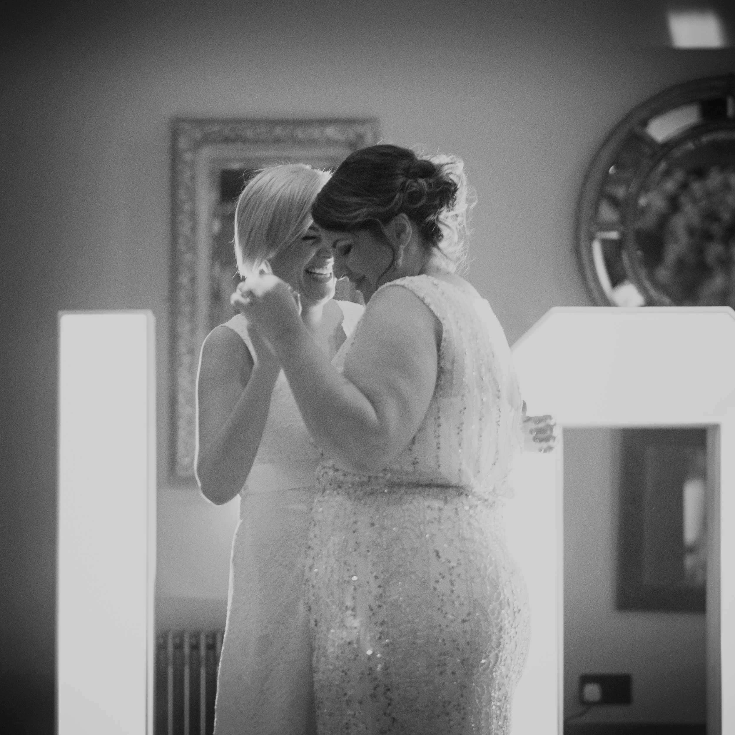 Black and white photo of first dance of two brides at same sex wedding