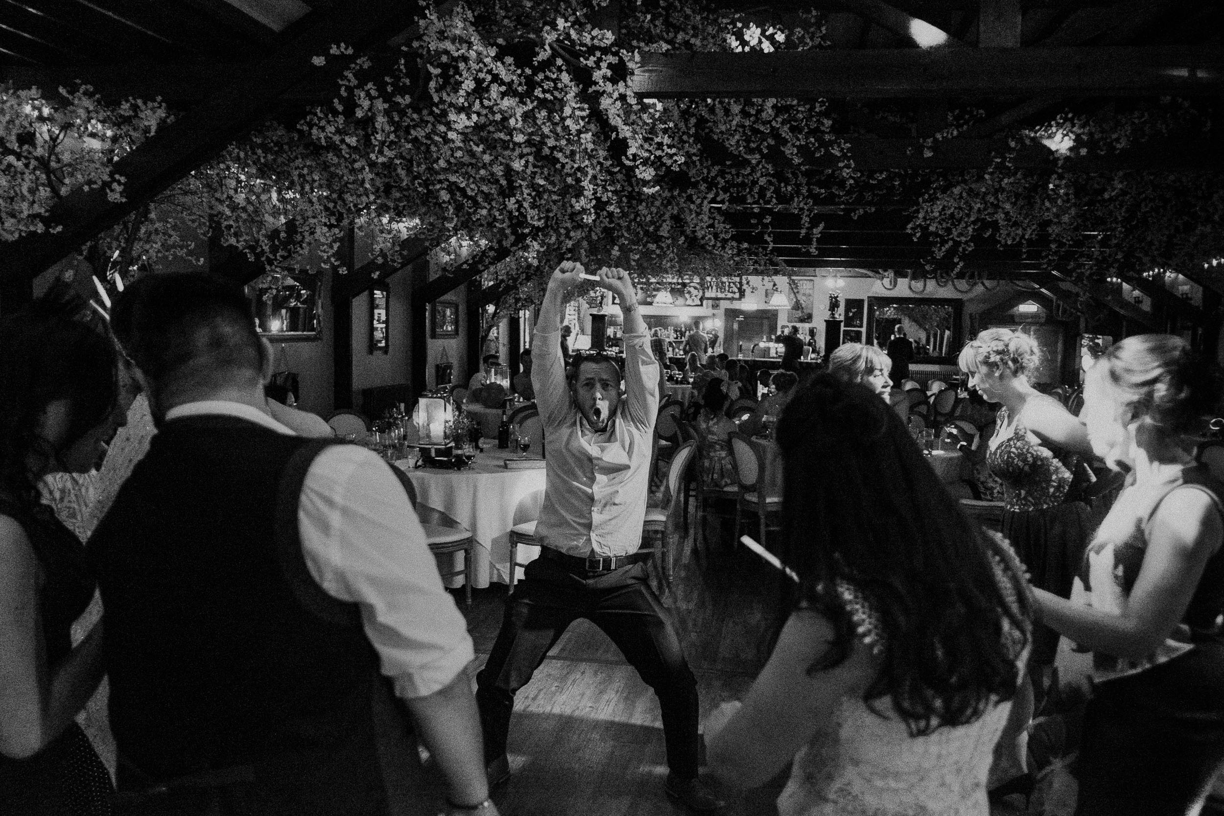 Black and white photo of guest pulling funny dance move