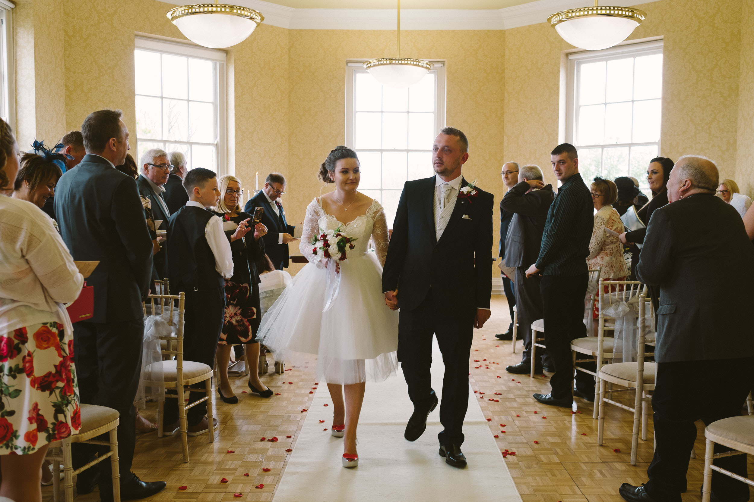 Bride and groom walking back down the aisle at the end of their wedding ceremony