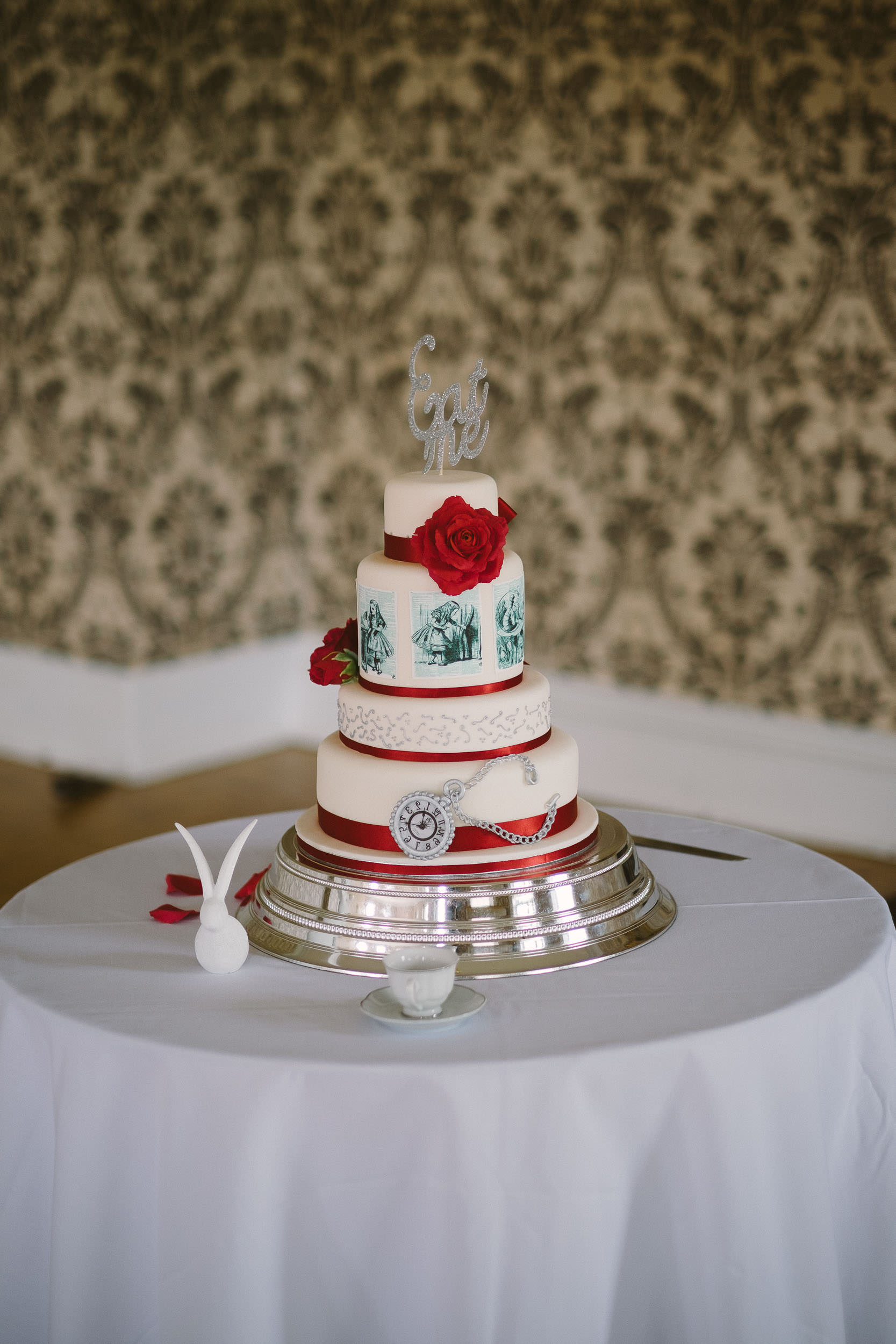 Wedding cake with Eat Me topper sign