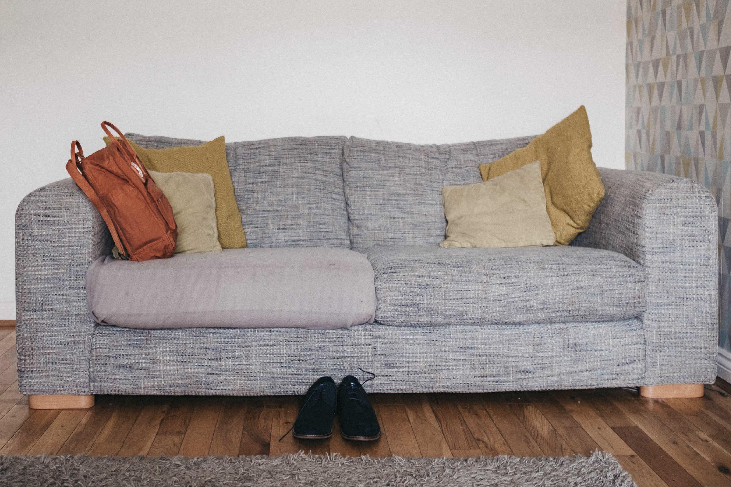 Groom's shoes and bag on sofa