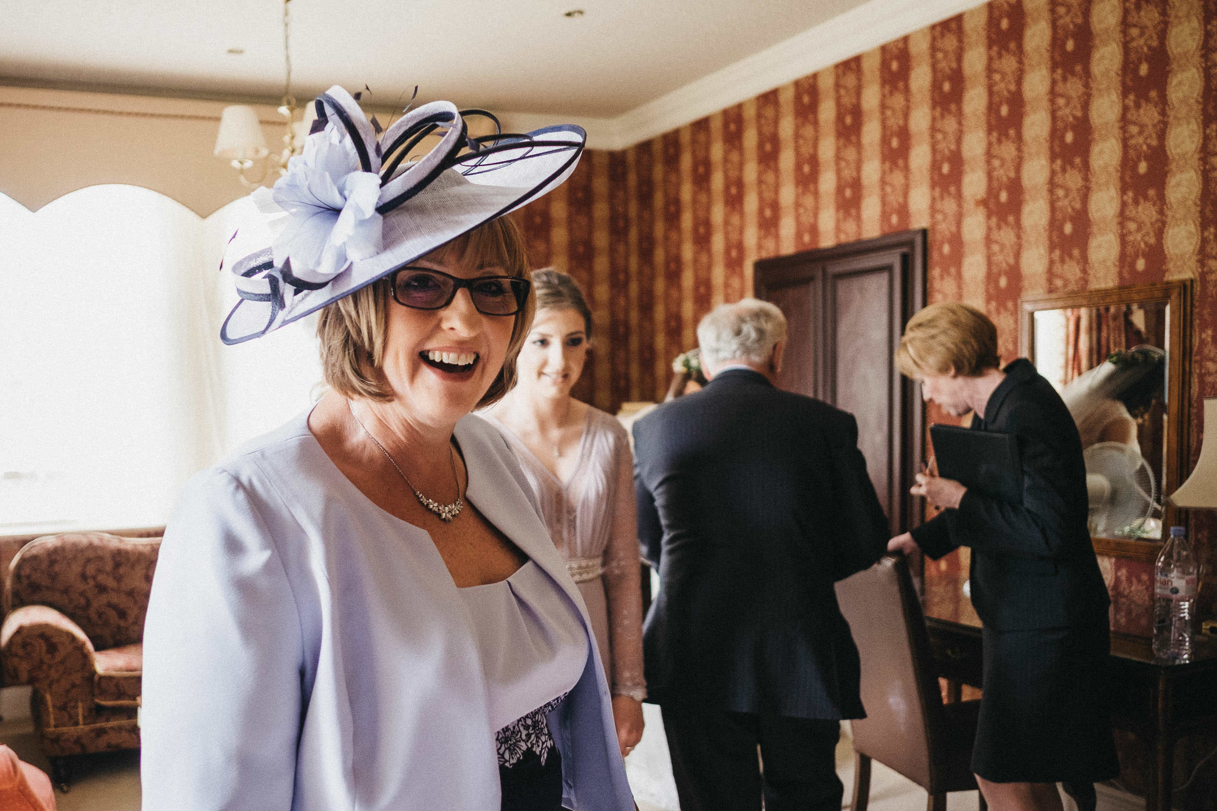 Mother of the groom laughing before ceremony