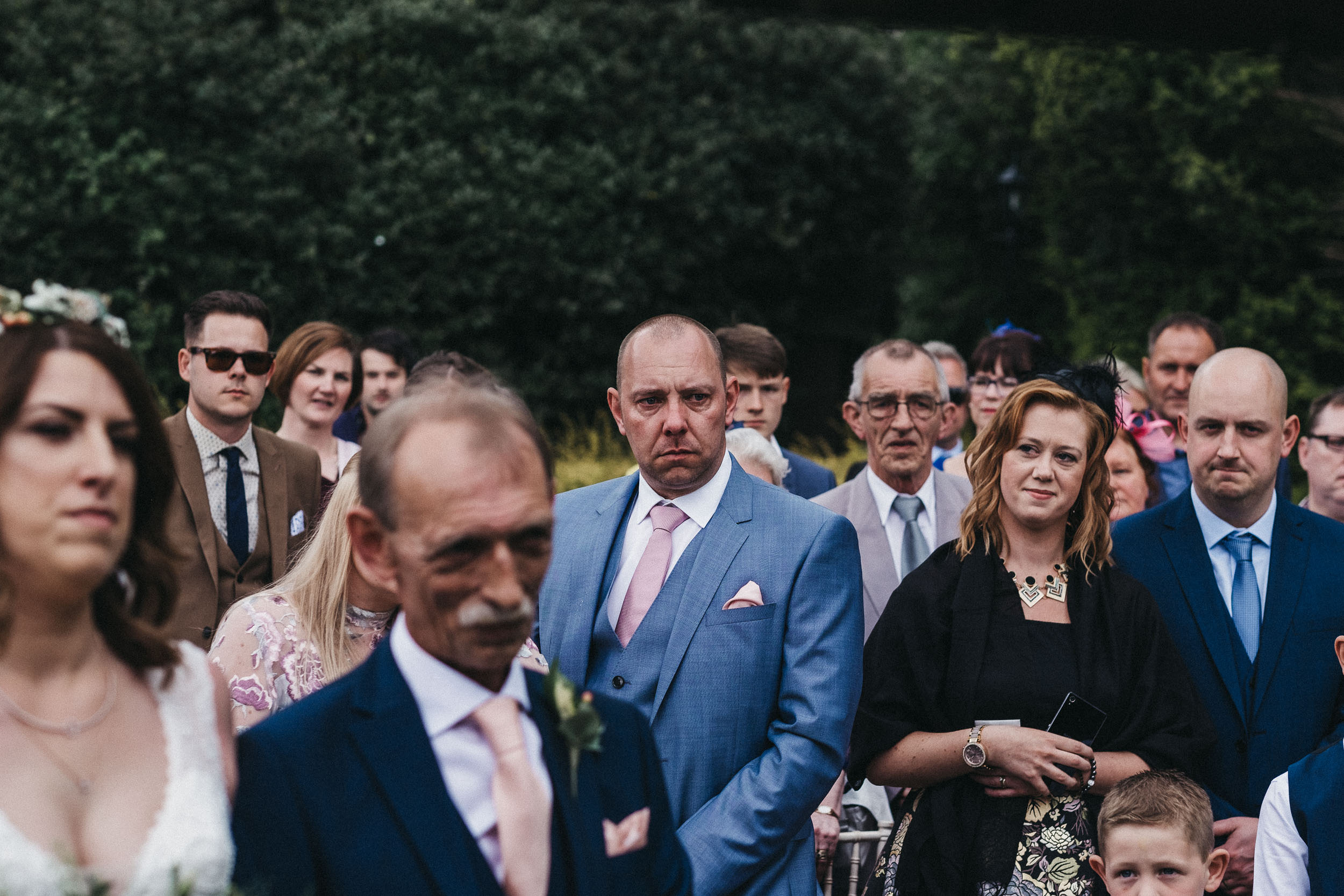 Tearful guest as bride arrives at end of aisle