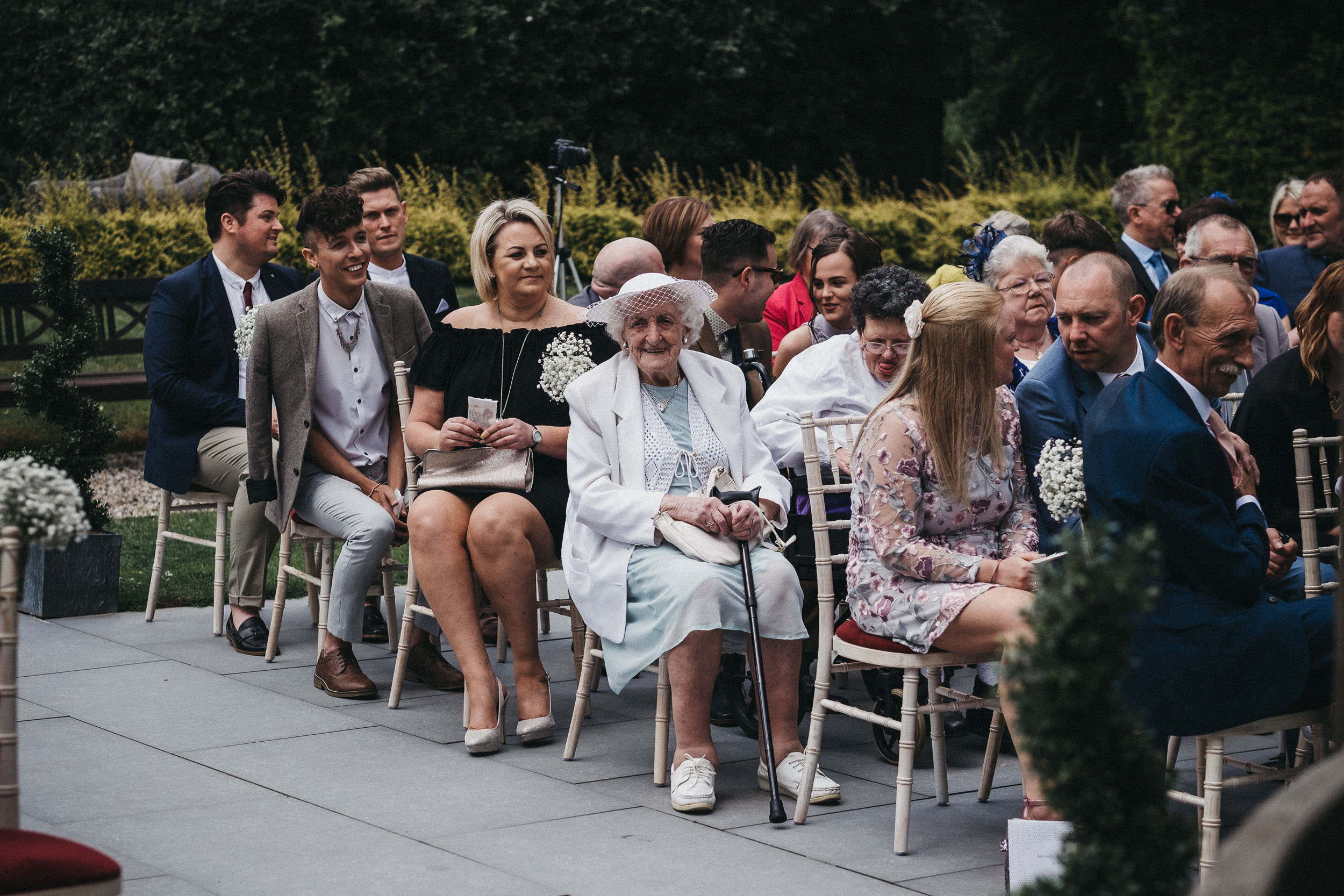 Guests watch outdoor wedding ceremony