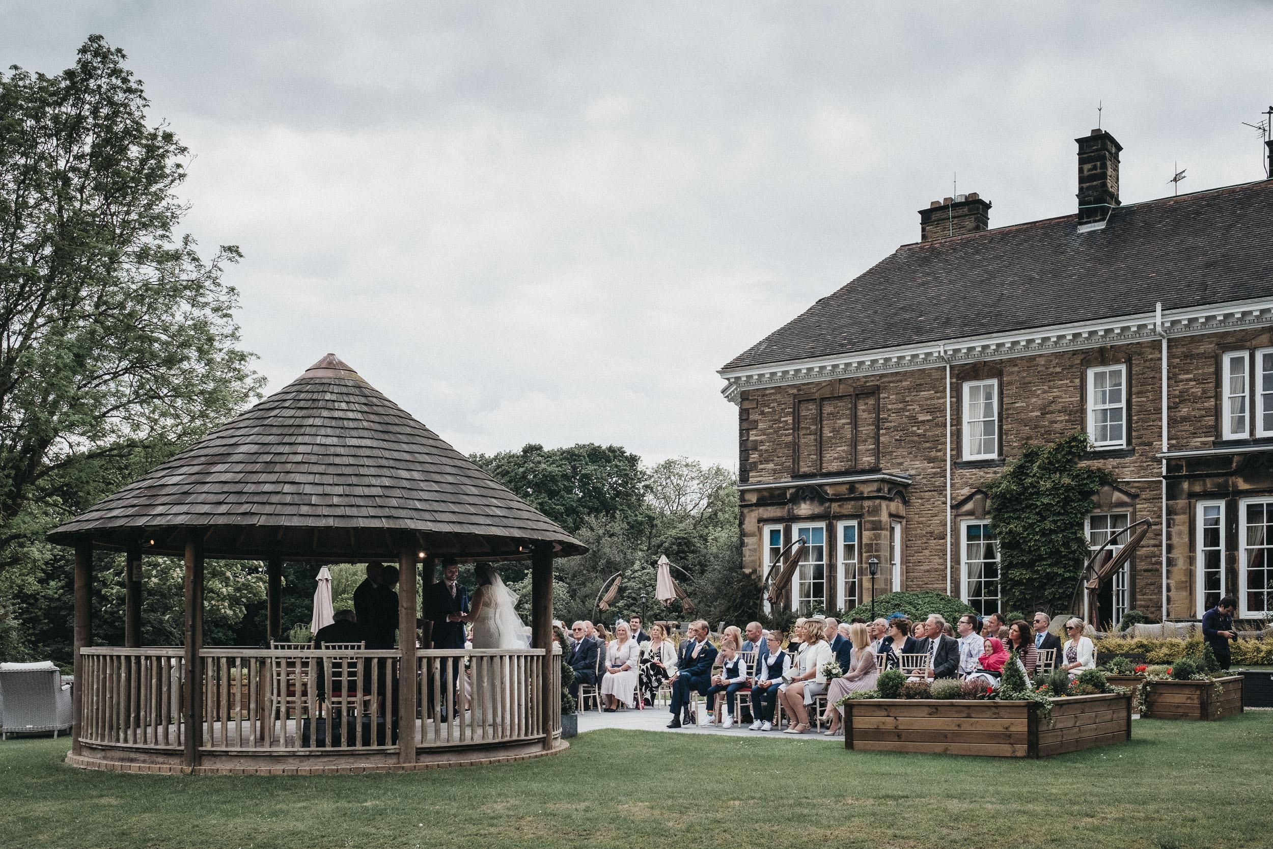 Wedding ceremony taking place in the gazebo at Judges at Kirklevington