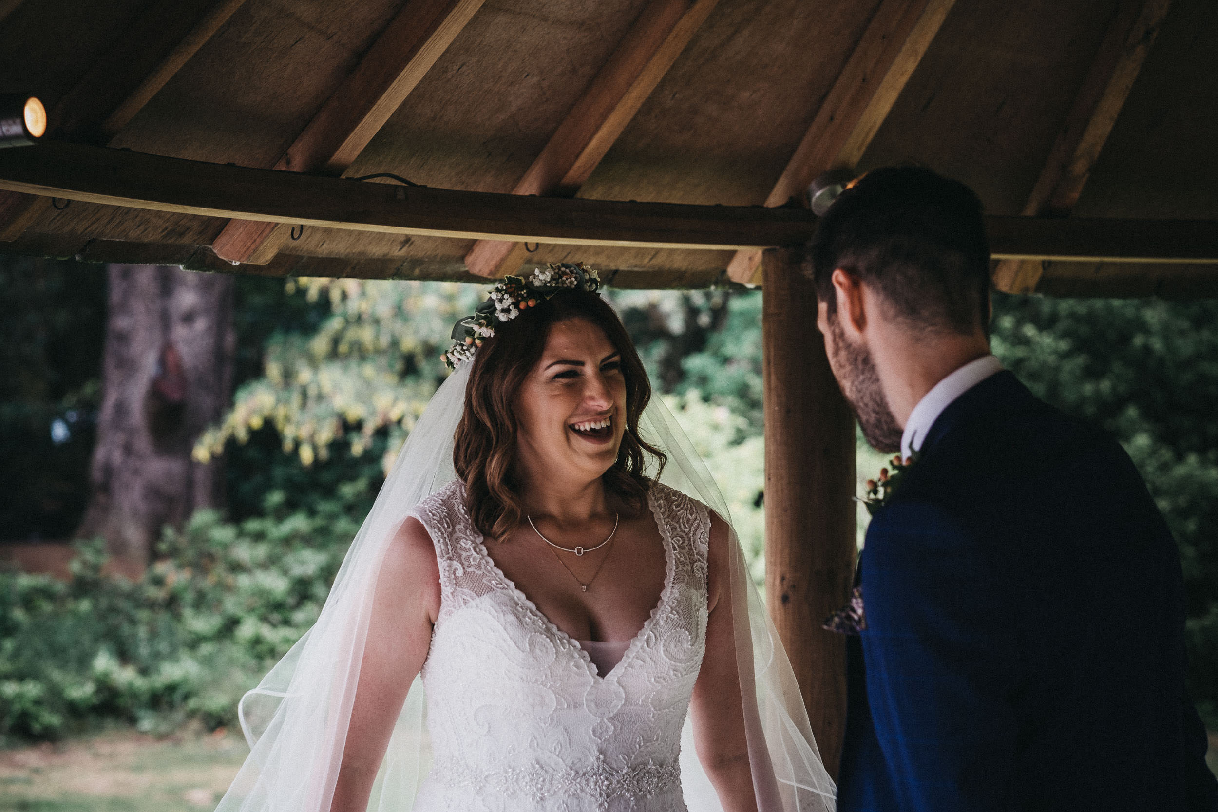 Bride laughing after wedding ceremony