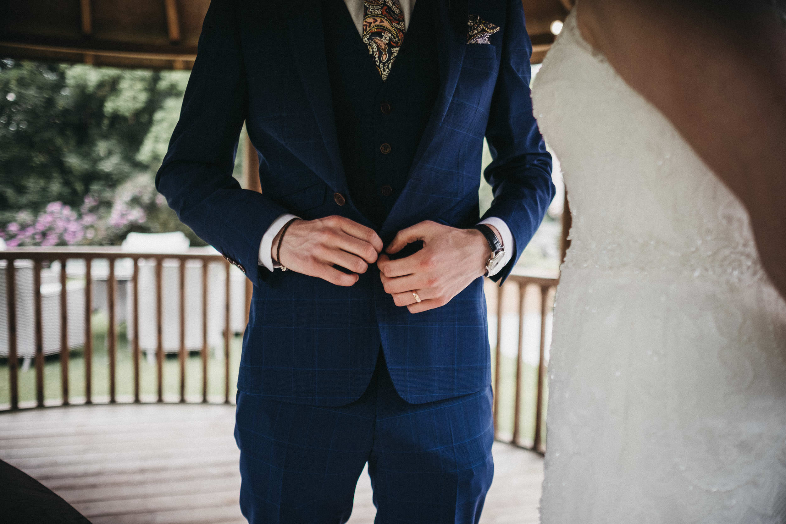 Close up of groom details - tie, pocket square, watch and ring