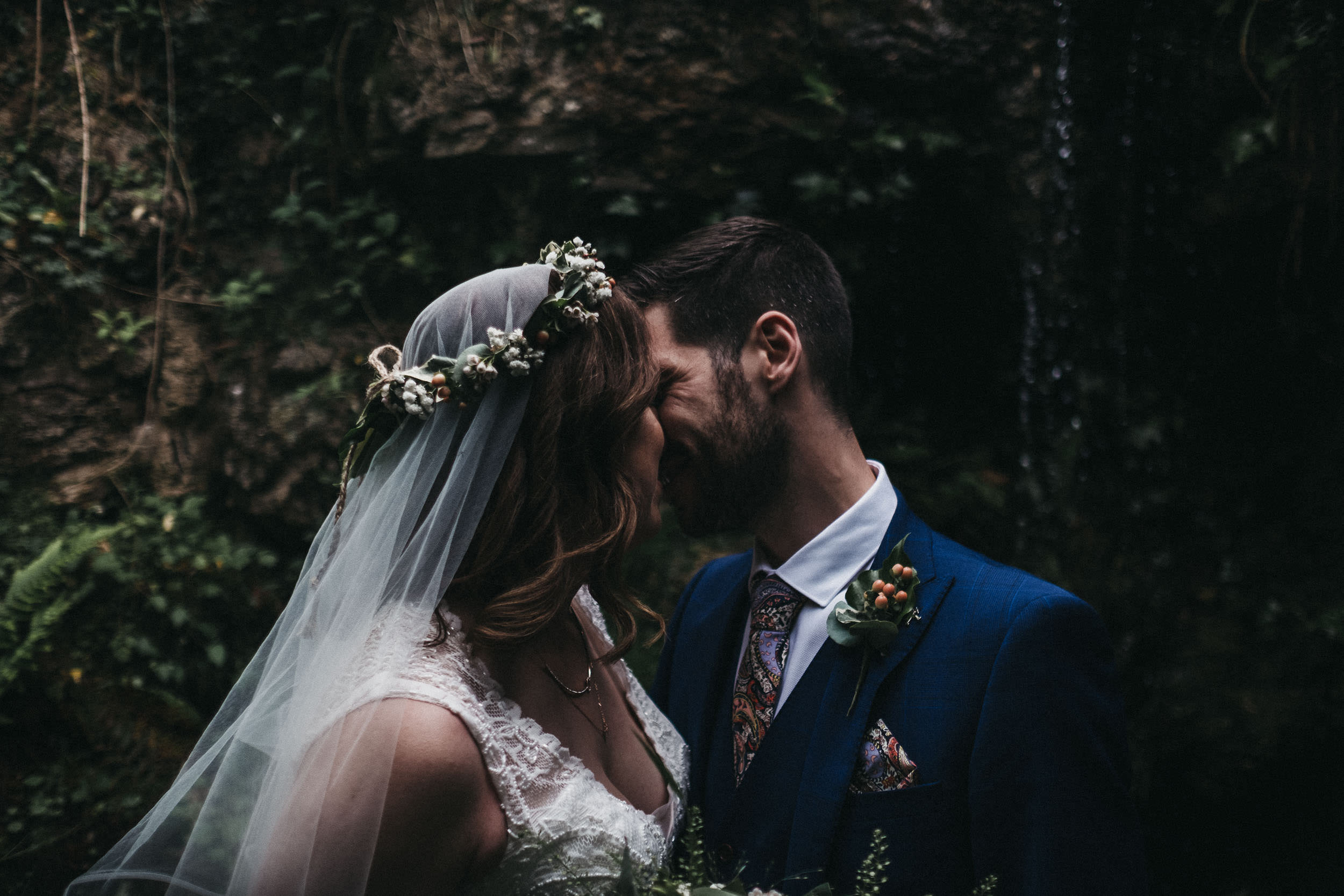 moody photo of bride and groom kissing