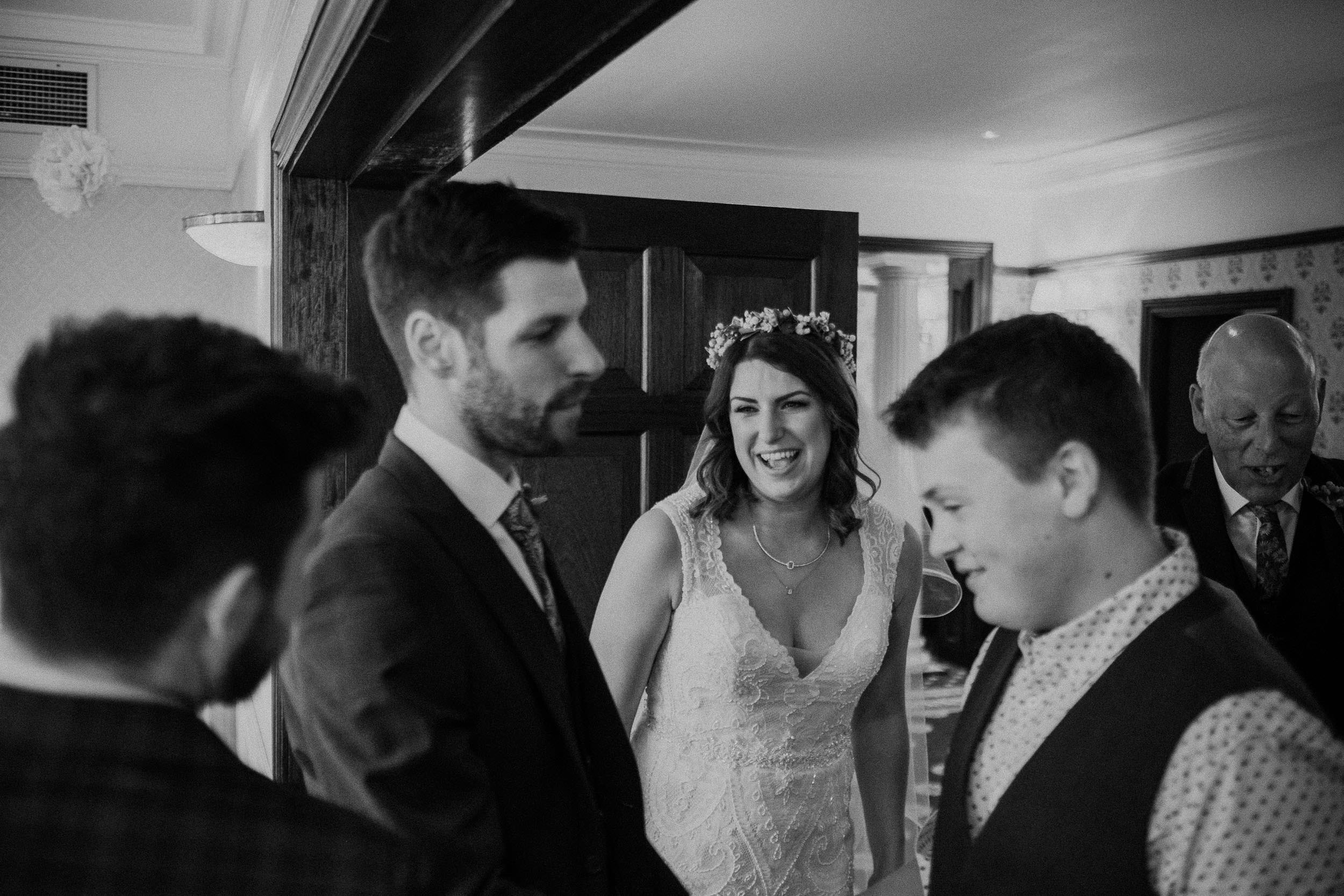 Black and white photo of bride laughing