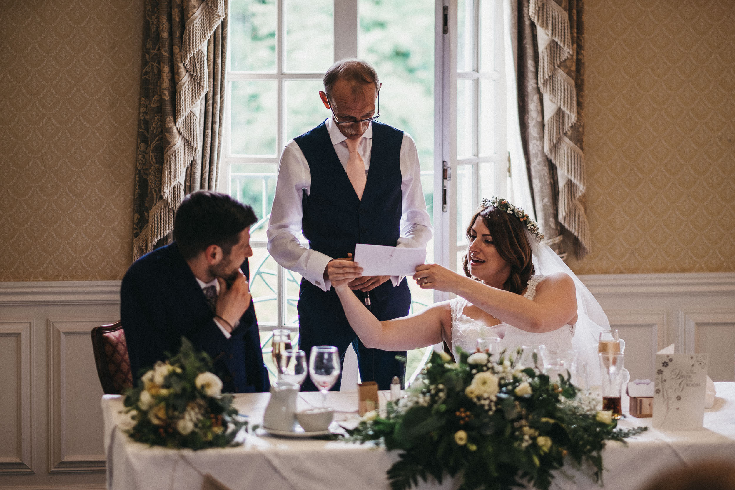 Bride holds up father's speech for him to read
