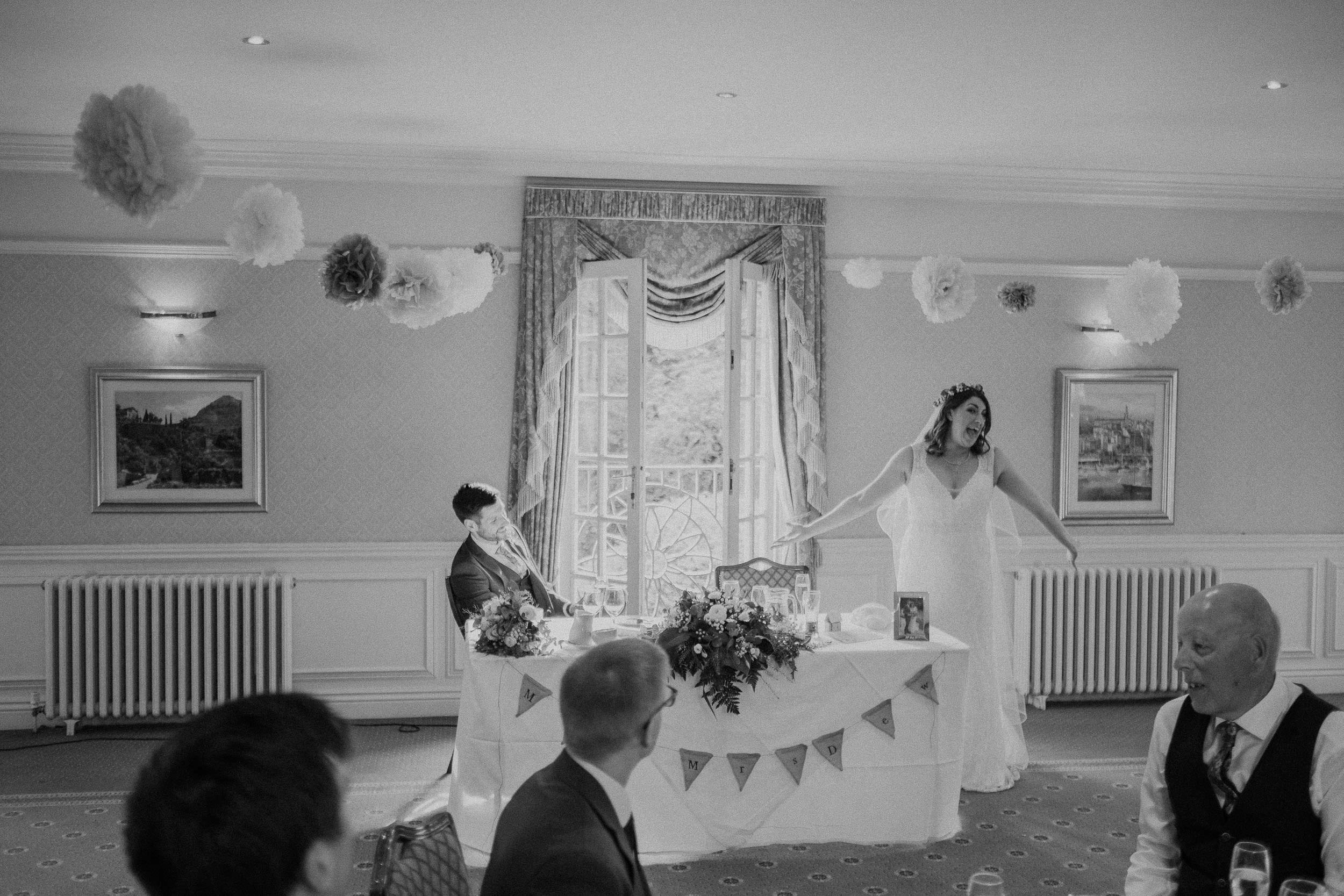 Black and white photo of bride making wedding speech