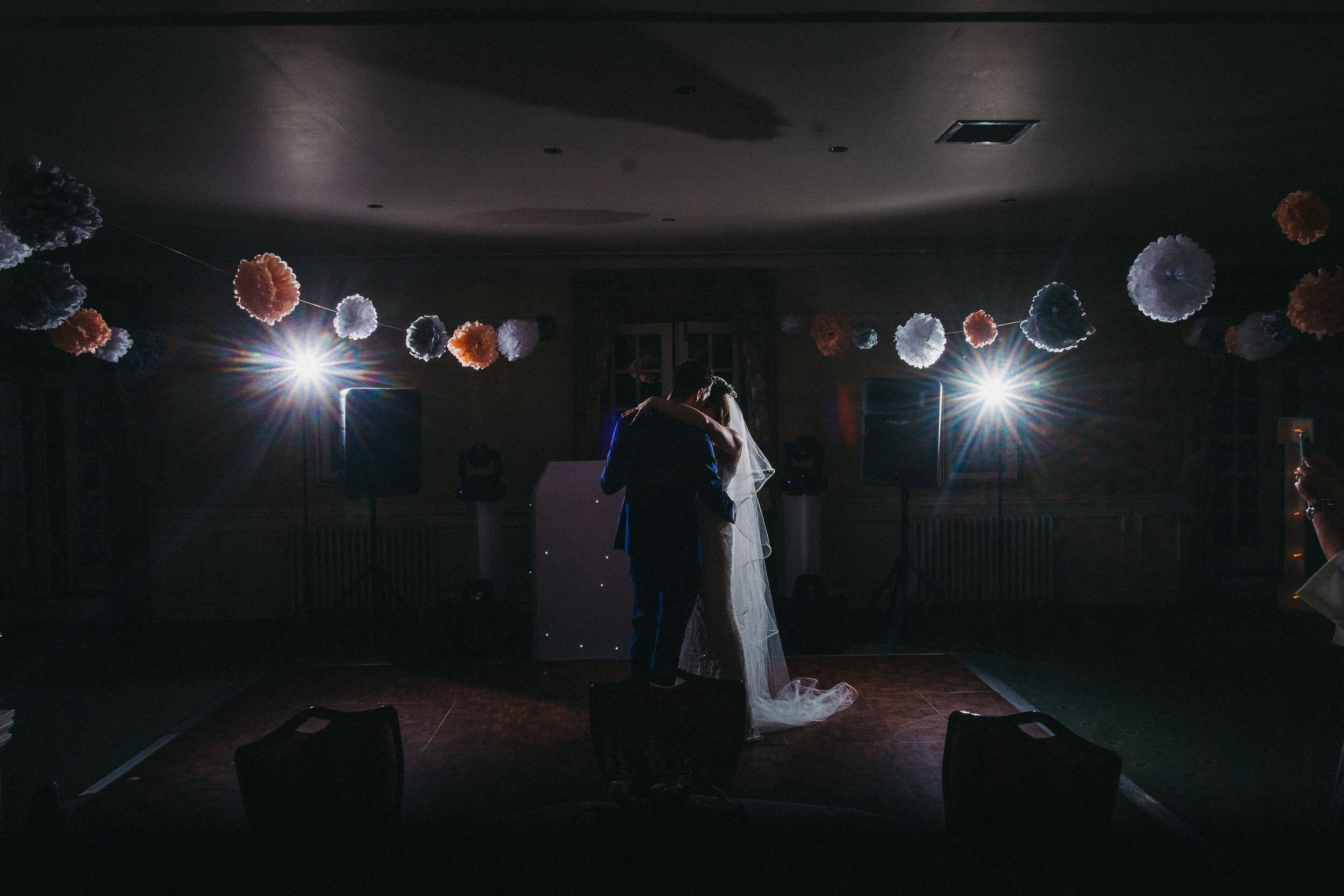 Dramatic photo of bride and groom first dance