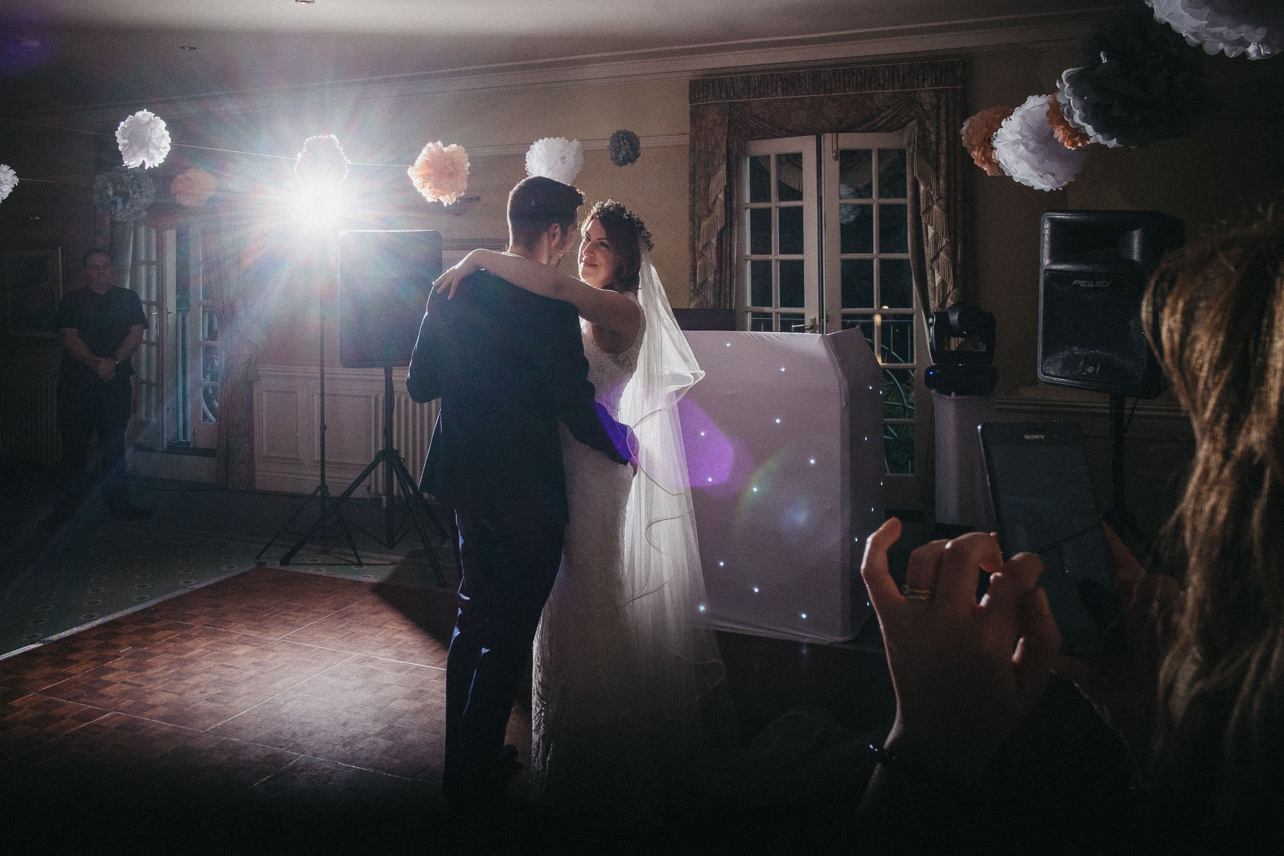Bride looks at groom romantically during first dance